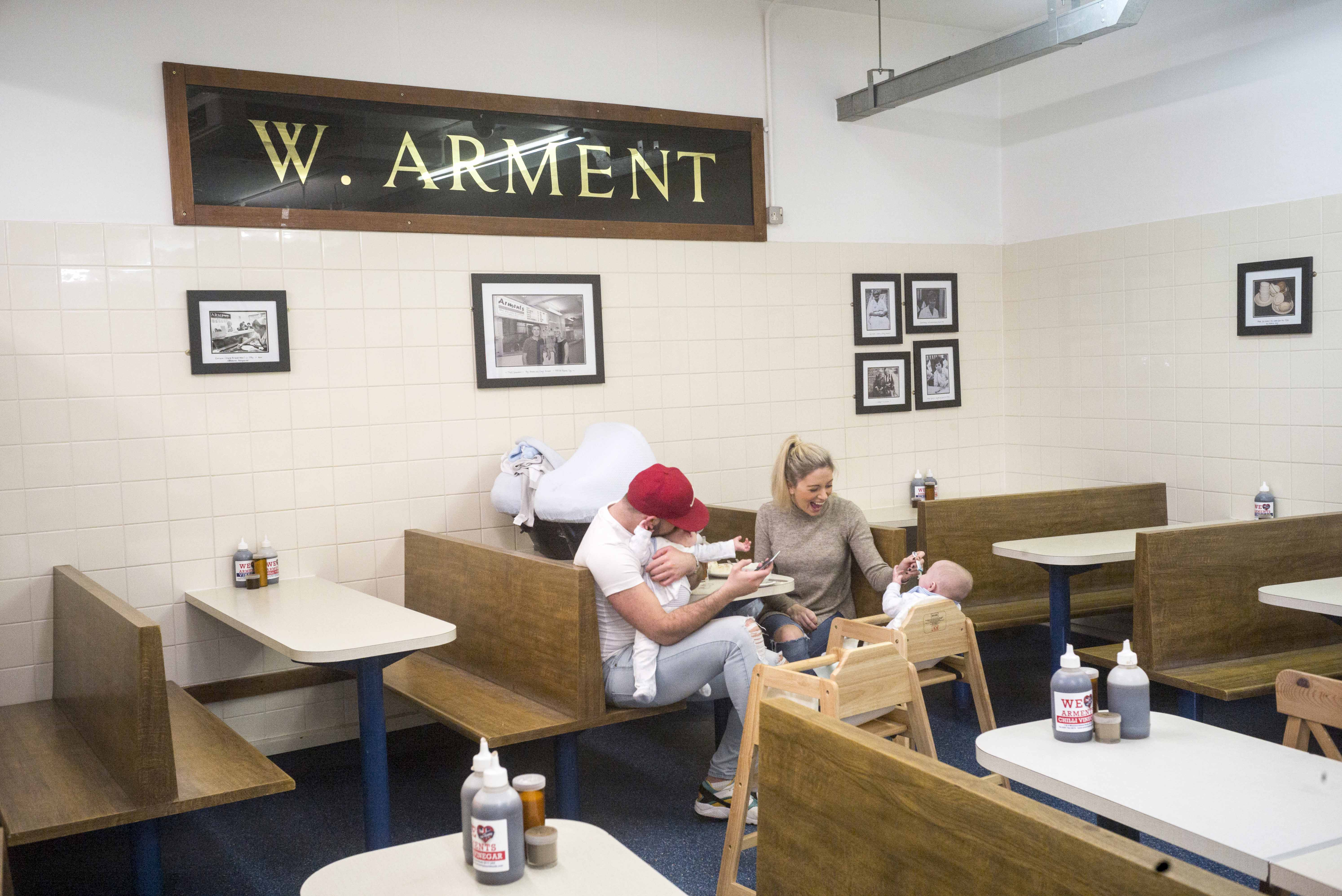 A family at Arments Pie and Mash shop