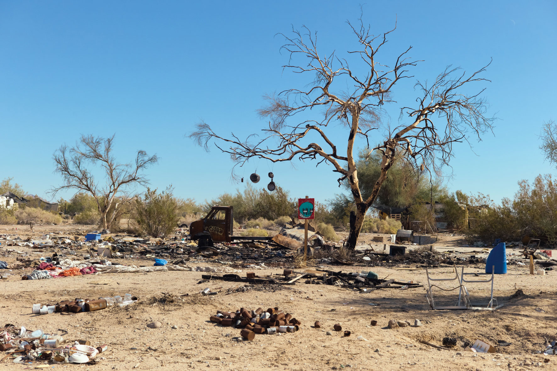 Burned down camp in Area 5, Slab City.