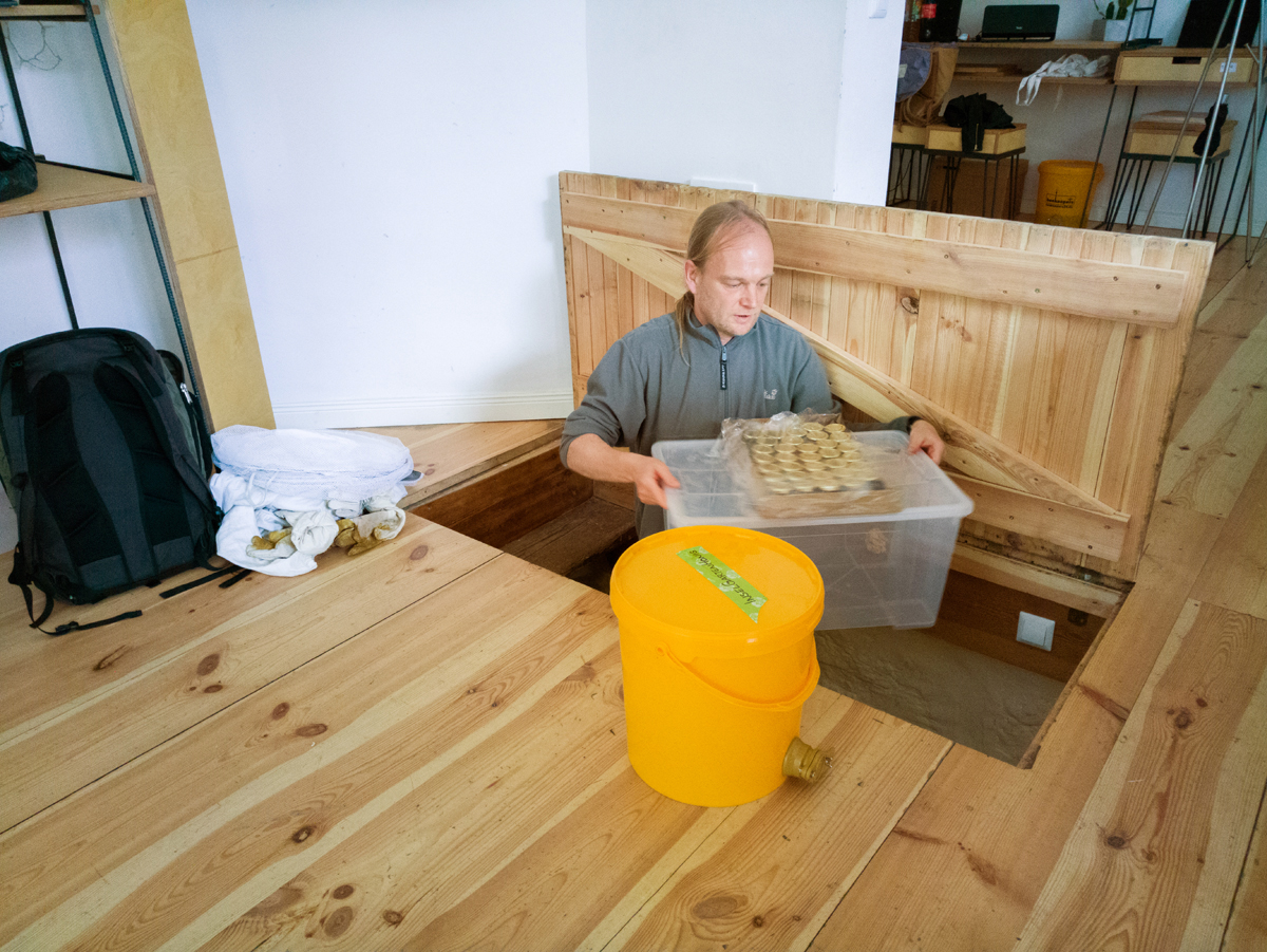 Karsten stores away the latest batch of honey from the estimated 60,000 bees they keep in the city.