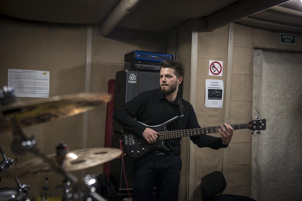 Yevhen Revko, 22 Bassist in Urban FM (center) practices with his band.