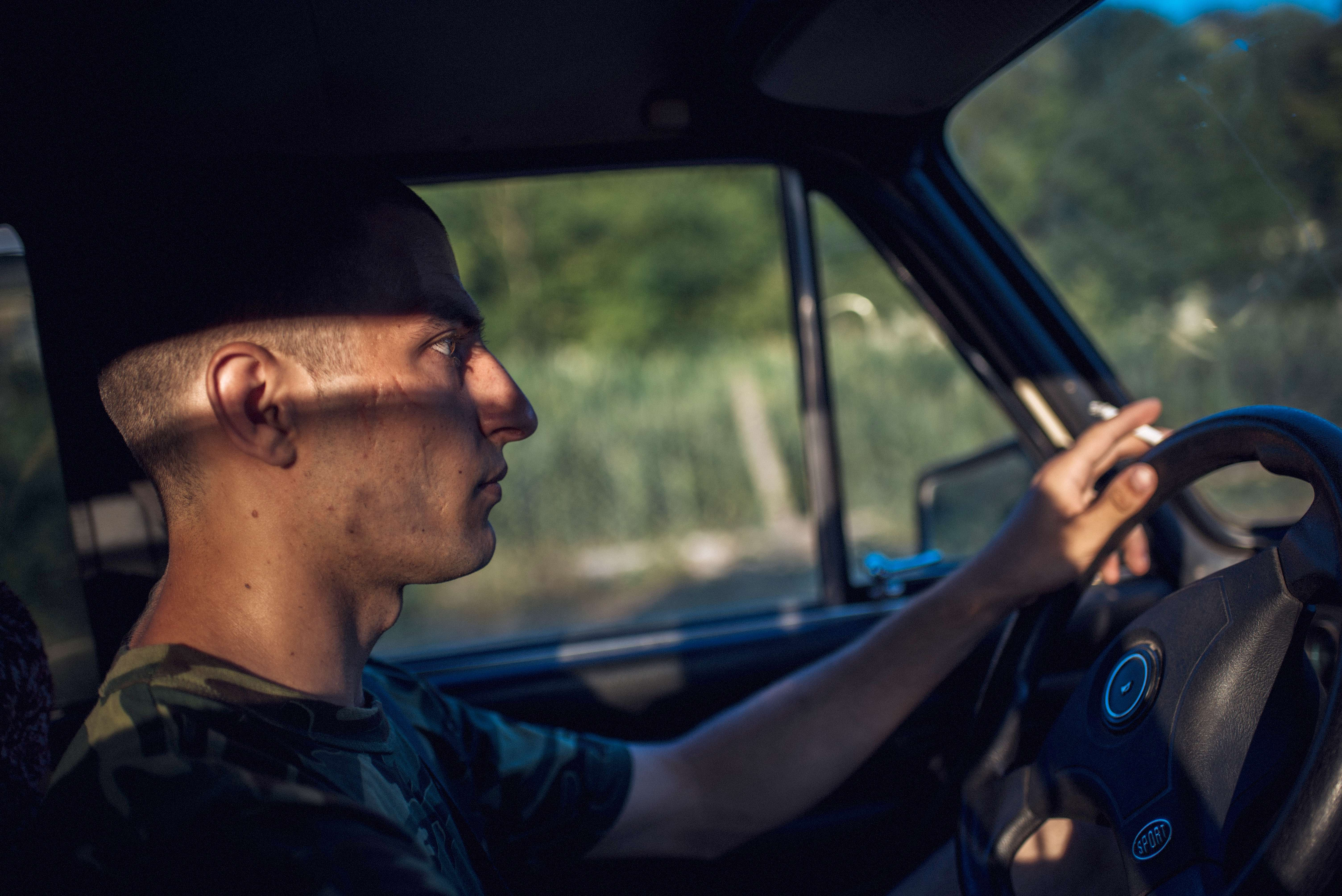 Yura makes extra money by driving people from Hristovaia to Camenca using his mother's old car, a Zhiguli.