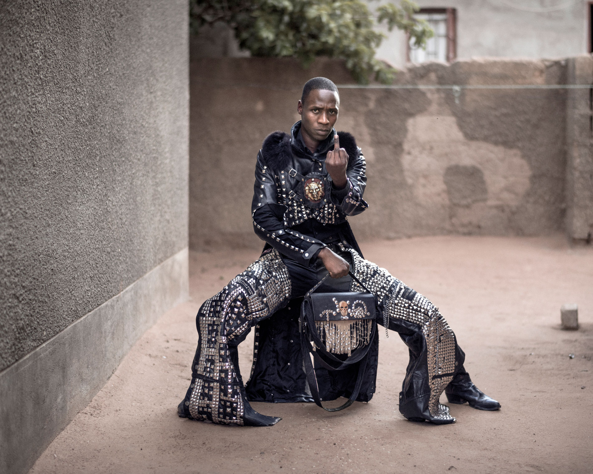 'Desert Super Power', a 26-year-old electrician, designs clothes for many of his peers in Botswana's metal scene.