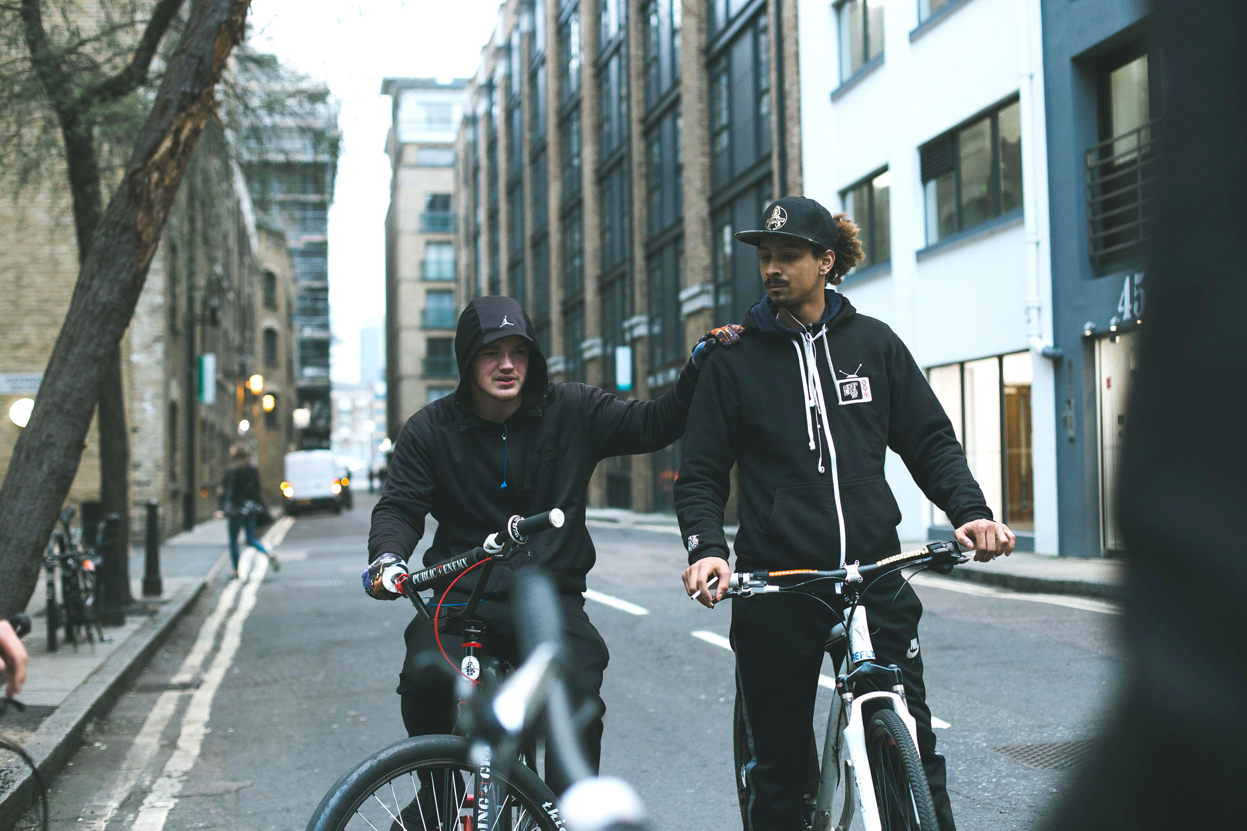 Jake and Kizzy, two of London Bikelife's biggest characters, catch their breath after practising tricks on a side street in Bermondsey.