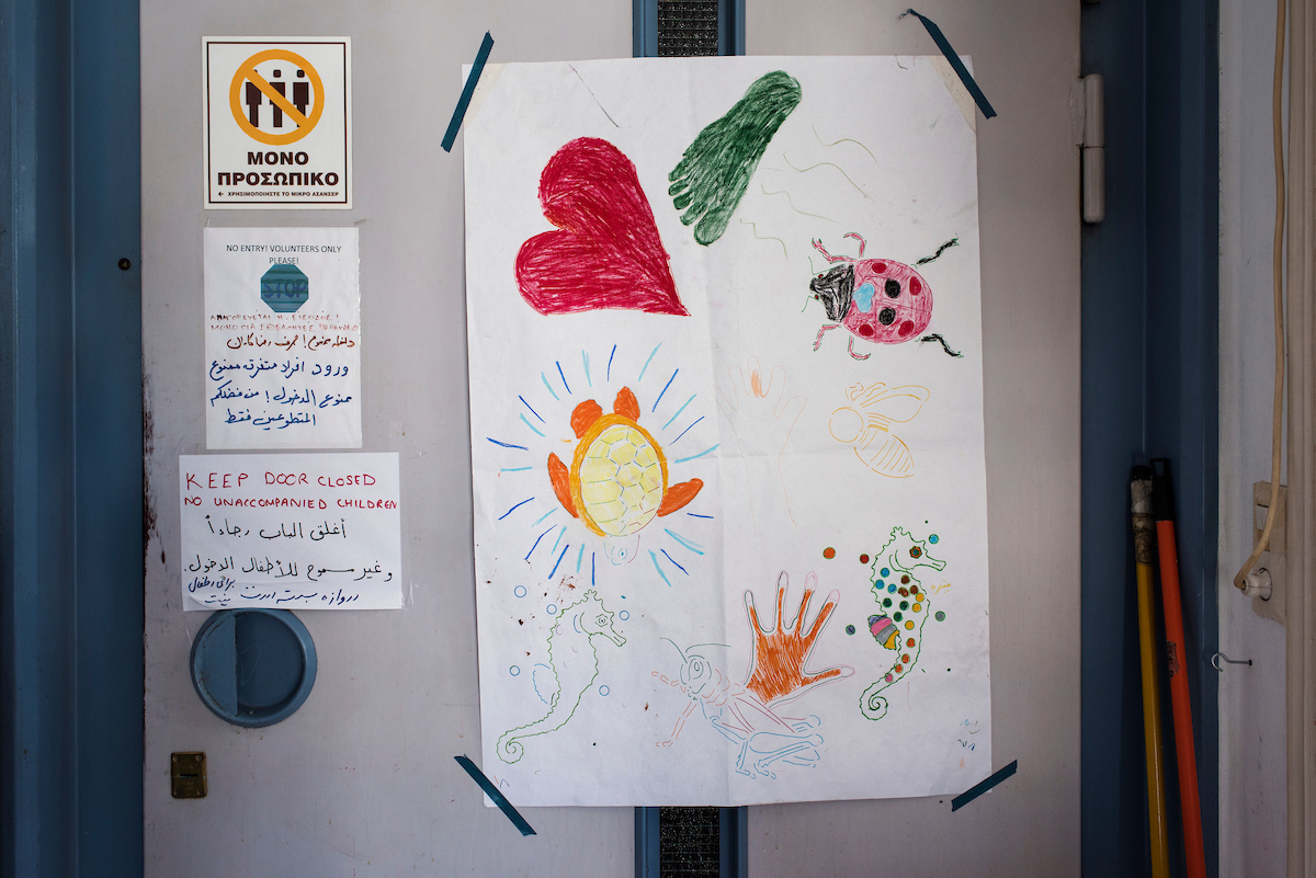 Kid's drawings on the lift door at Khora, refugee centre in Athens.