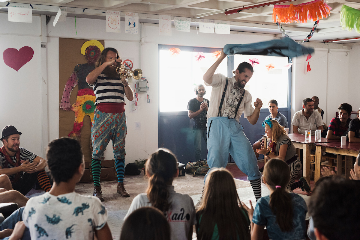 A circus performance by the Flying Seagull Project at Khora, refugee centre in Athens.