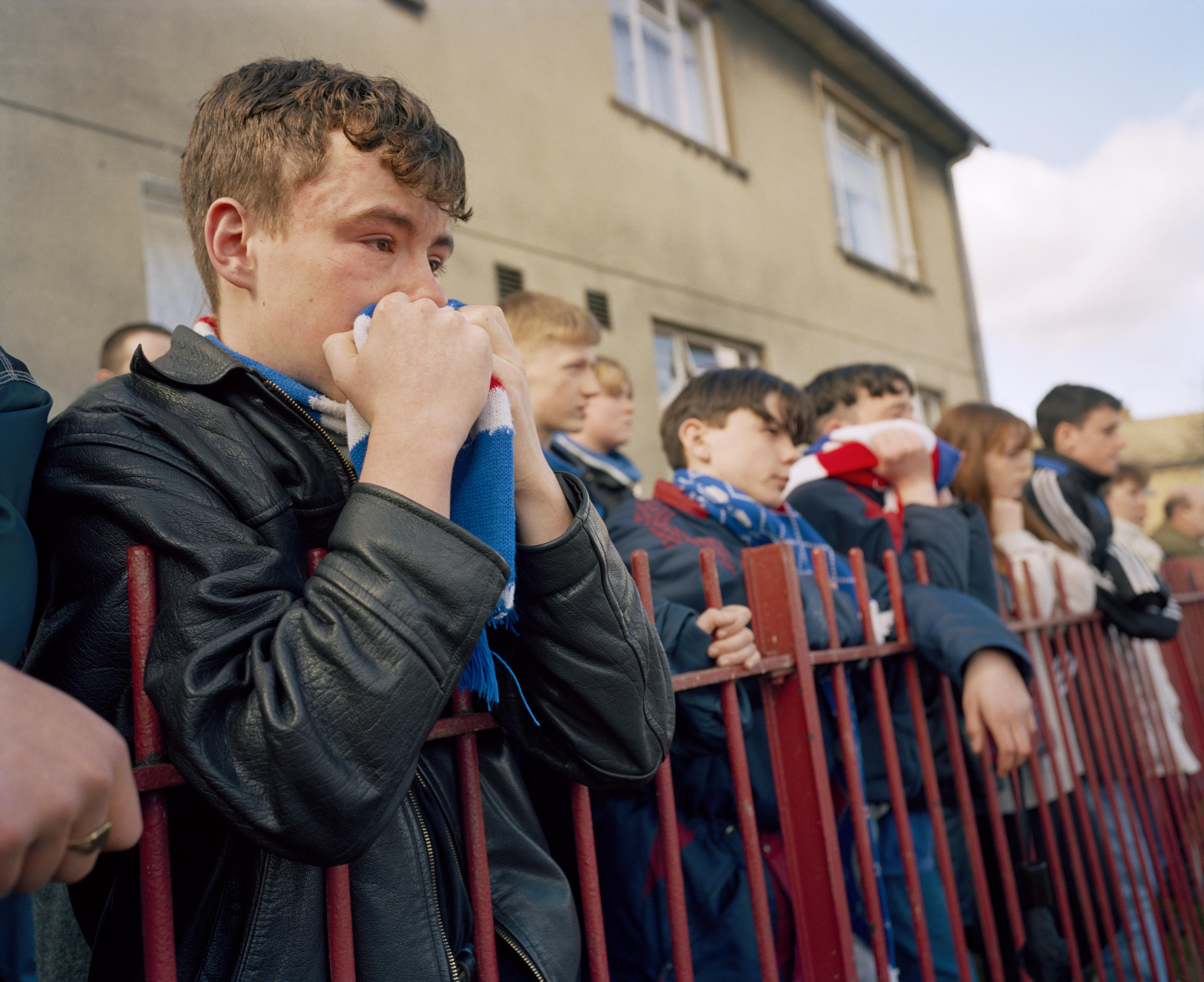GB. Scotland. Glasgow. Rangers fans at the funeral of player Davie Cooper. He died of a brain haemorrhage, three years after retiring from the game. 1995. © Martin Parr/Magnum Photos