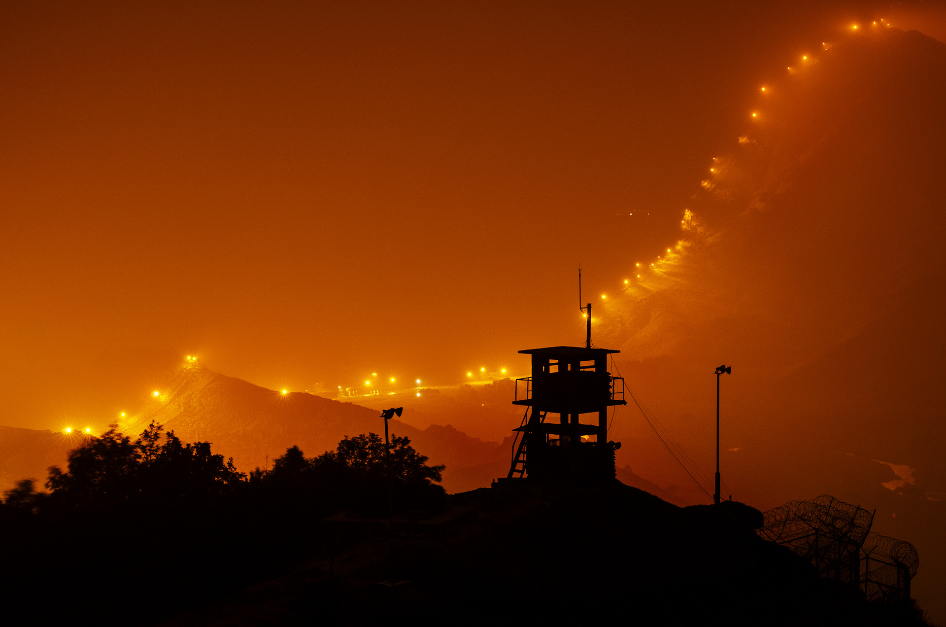 After sunset, countless lamps illuminating 248km of the DMZ fence to prevent enemy infiltration.
