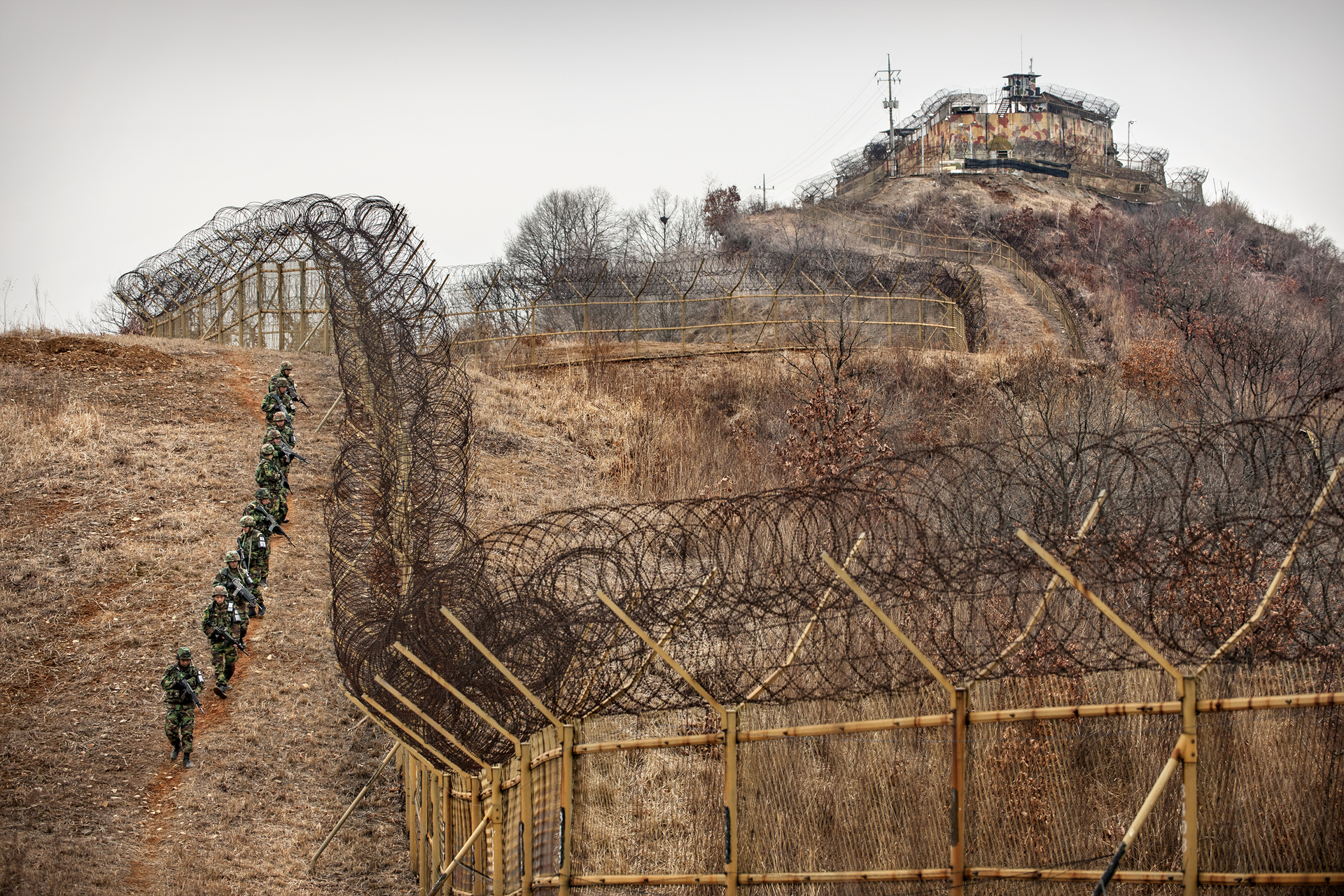Squad along the barbed-wire fence of South Korean GP inside of the DMZ.