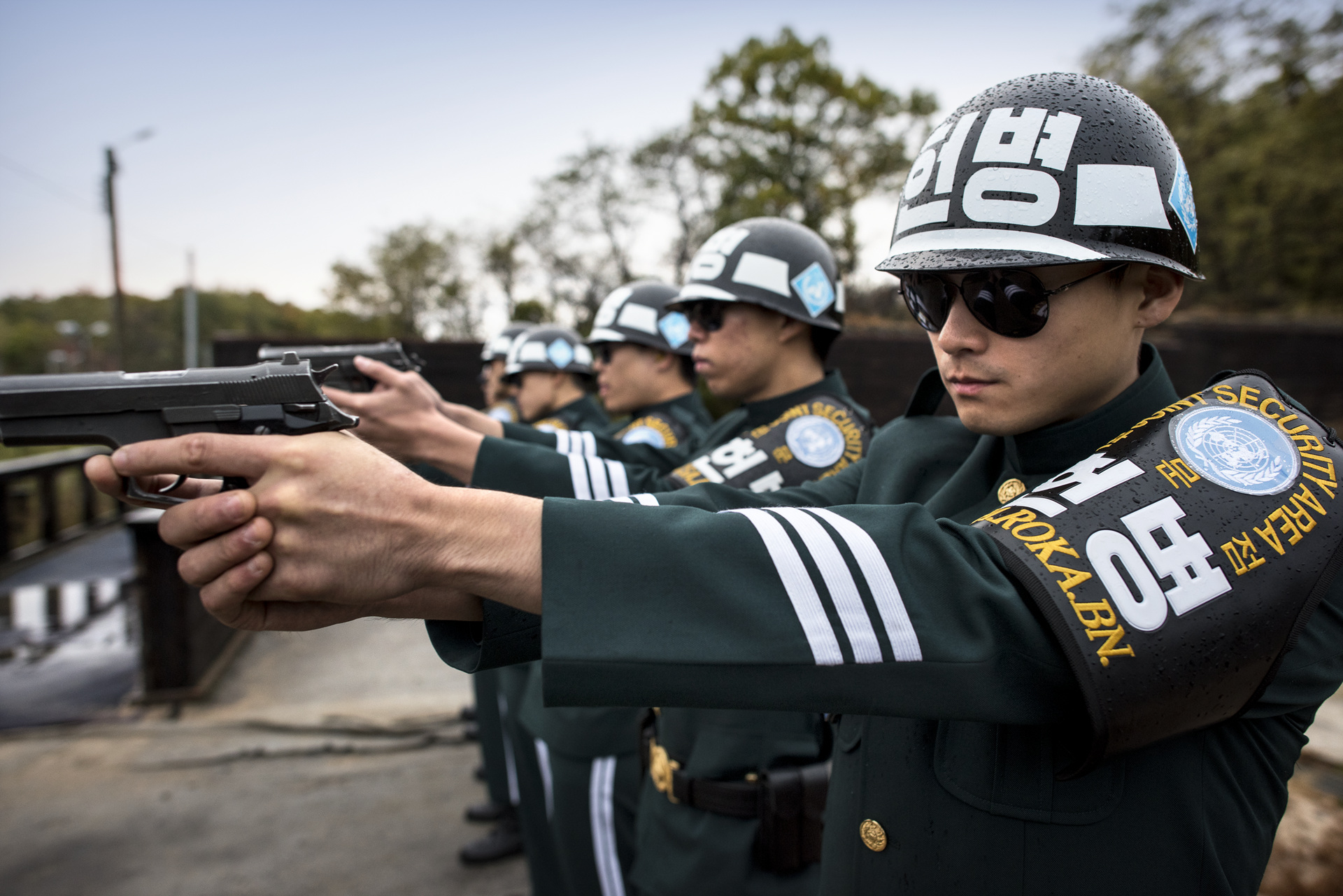 South Korean JSA (Joint Security Area) cordon soldiers practice pistol shooting at the firing range.