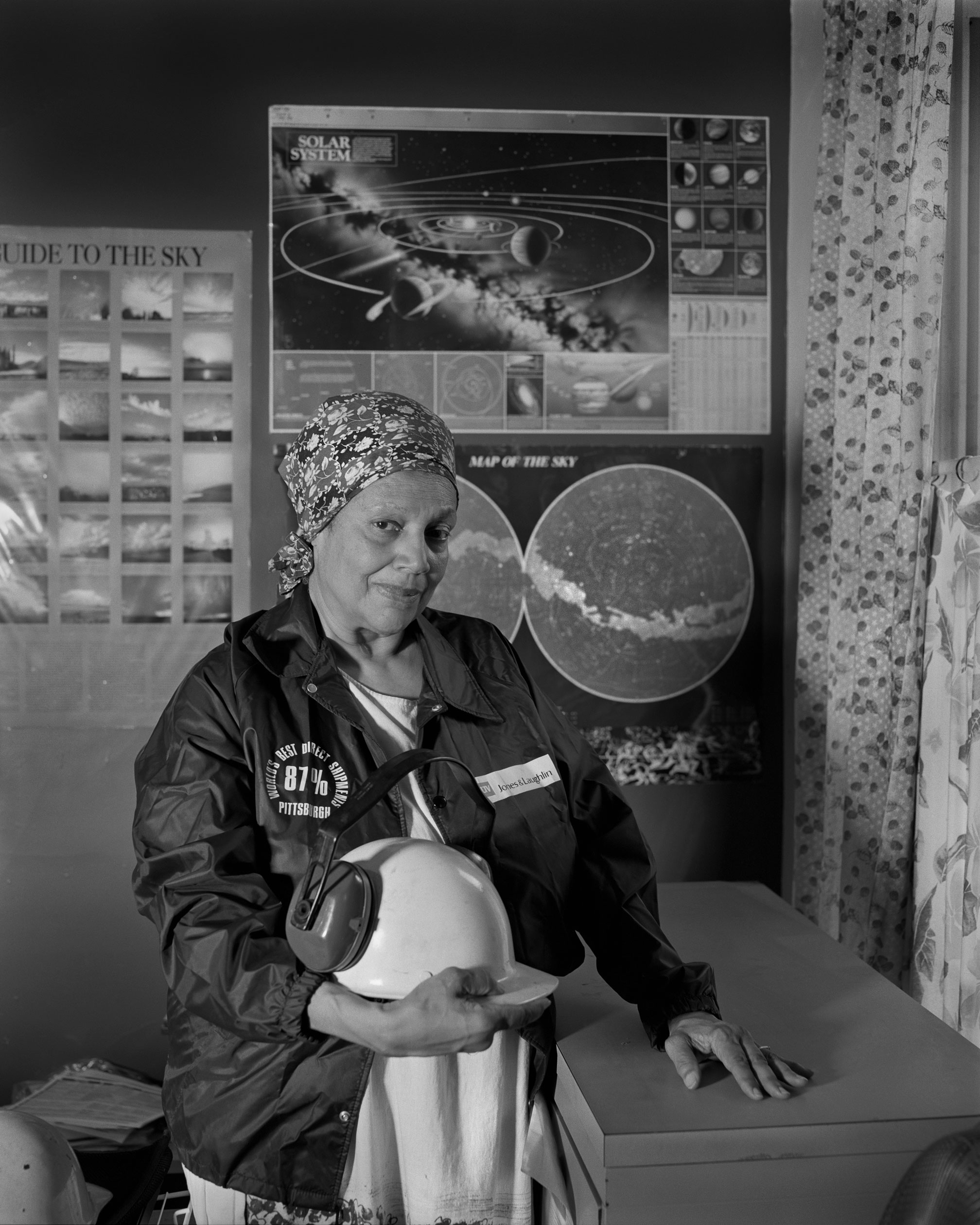 "Sandra Gould Ford in Her Office in Homewood PA, 2017. LaToya Ruby Frazier. Courtesy of the artist and Gavin Brown's enterprise, New York/Rome. ""Sandra Gould Ford is a renaissance woman who lives in Homewood, Pennsylvania. For eight years, she worked as a secretary at the steel mill Jones & Laughlin. Even though it wasn't permitted to photograph on the grounds, she snuck her cameras in to document workers' lives with deep compassion for over two decades. The images are so beautiful that they look like Precisionist paintings – yet she's been completely overlooked by the history of art in Pittsburgh. My latest project, On the Making of Still Genesis: Sandra Gould Ford, is all about this incredible work which has gone ignored."""