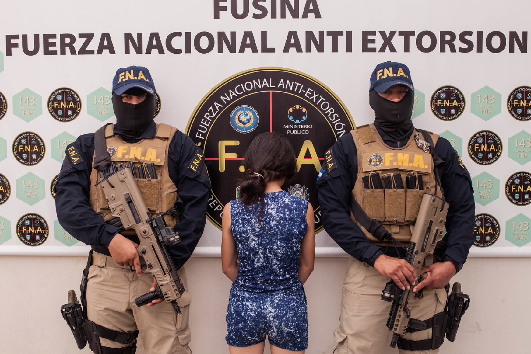A 16-year-old girl, arrested for extortion, is presented to the press by the police in Tegucigalpa. Teenagers in Honduras are often used to carry out extortion for gangs, their family's lives are threatened if they do not cooperate. If they are caught, like this girl, they will go to prison for taking part in the crime. 9th August 2017.