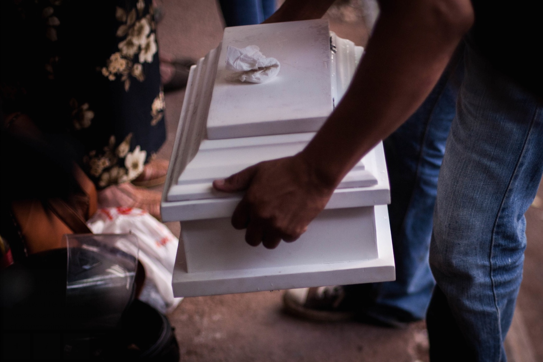 The coffin of a baby is removed from the forensic morgue in Tegucigalpa. 11th August 2017.
