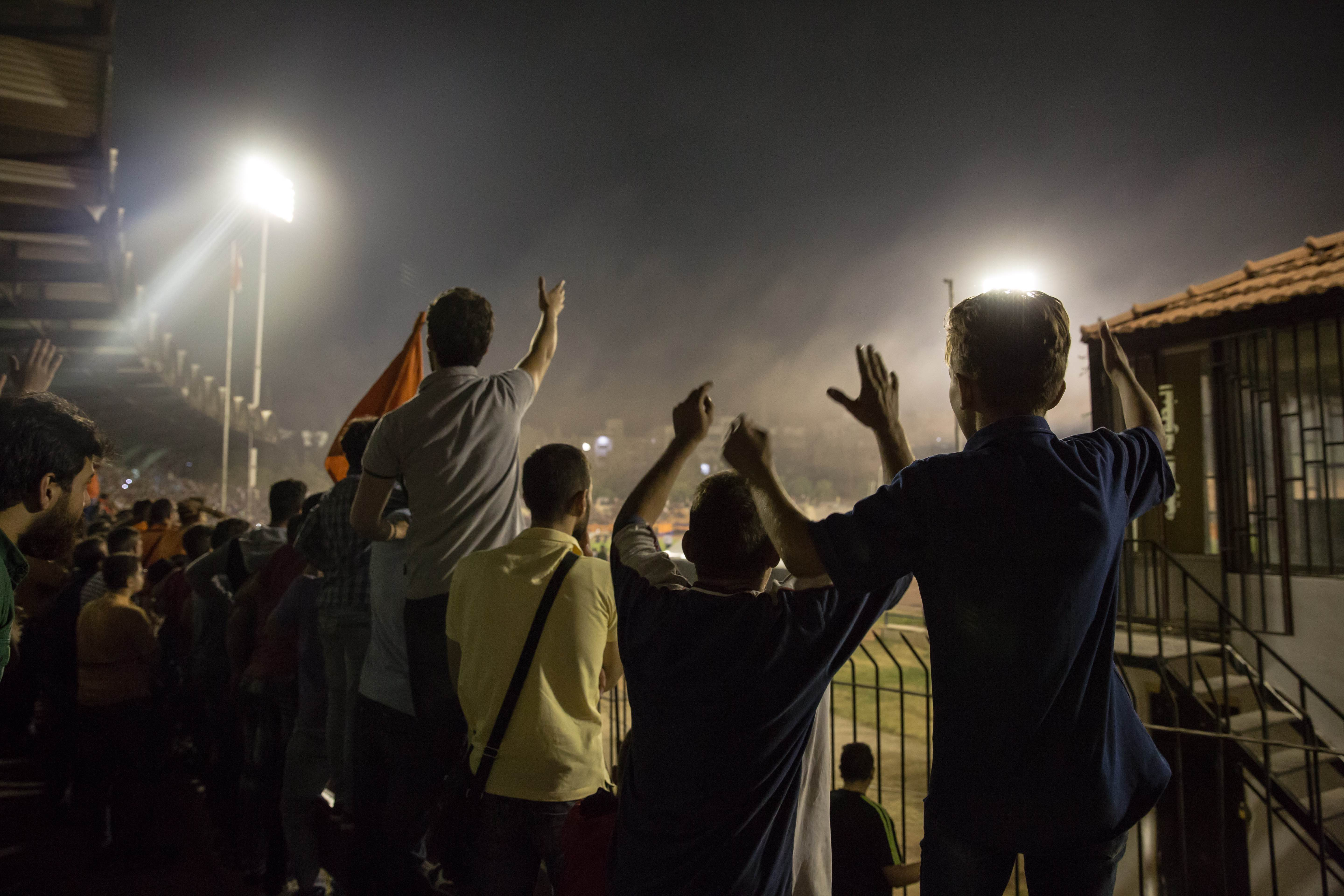 Al-Wahda fans cheer as their team gains advantage.
