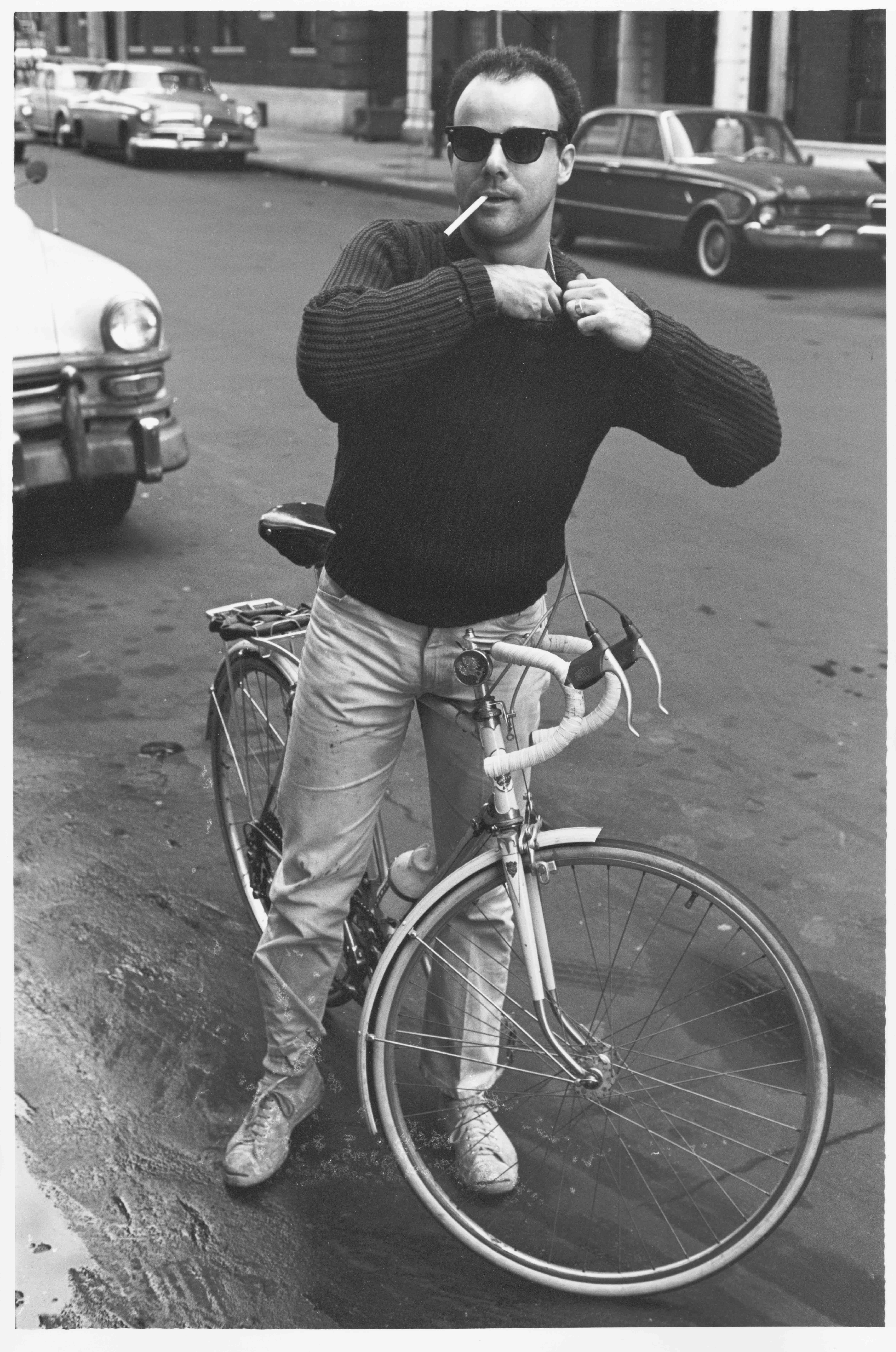 Mark Berghash on his bike, taking a break from his painting studio, 1964