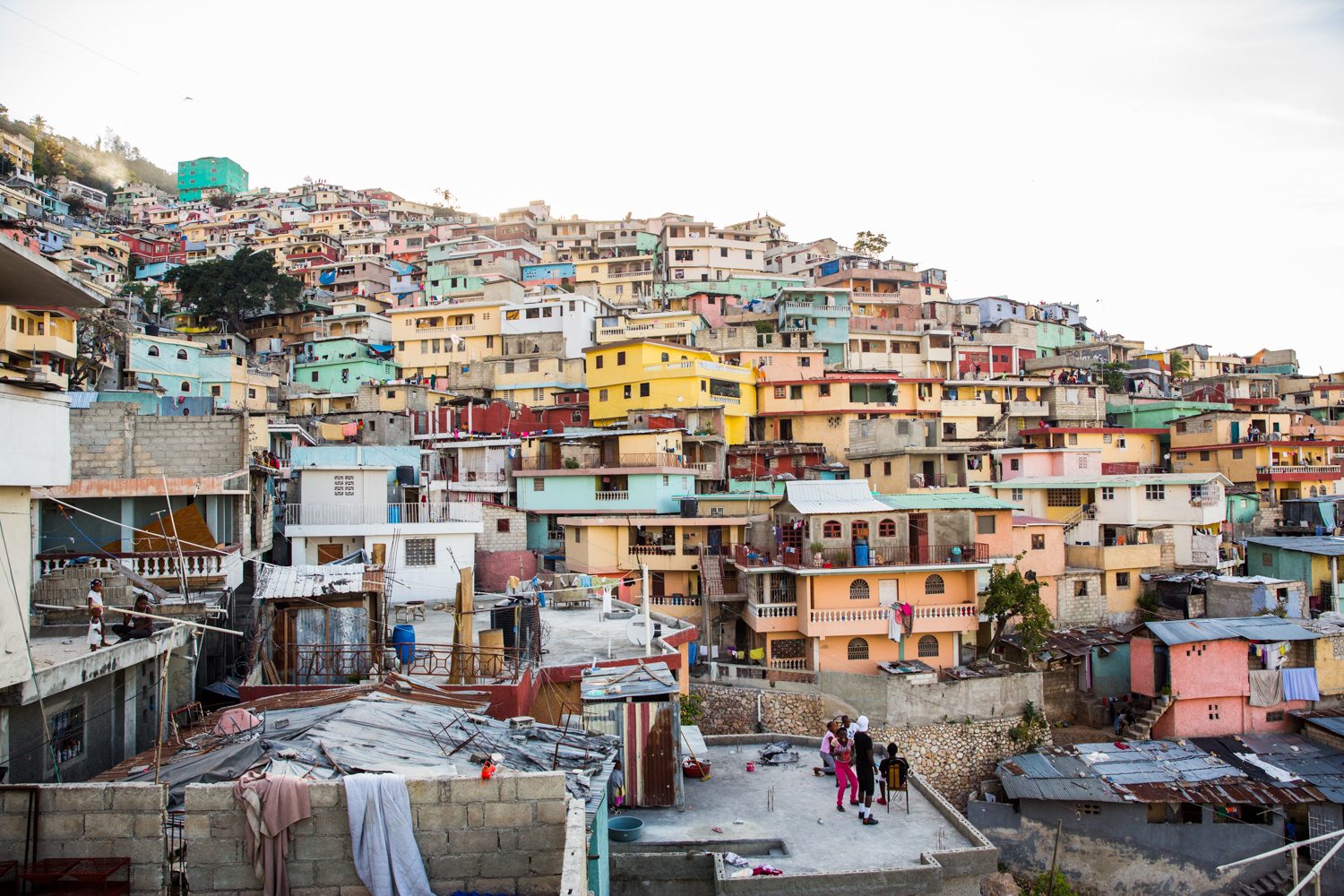 Jalouzi City, the largest slum in Port-au- Prince. In 2015, the houses were painted in color to uplift the community and bring hope. This mission was started by aresident and painter of Jalouzi, Duval Pierre.