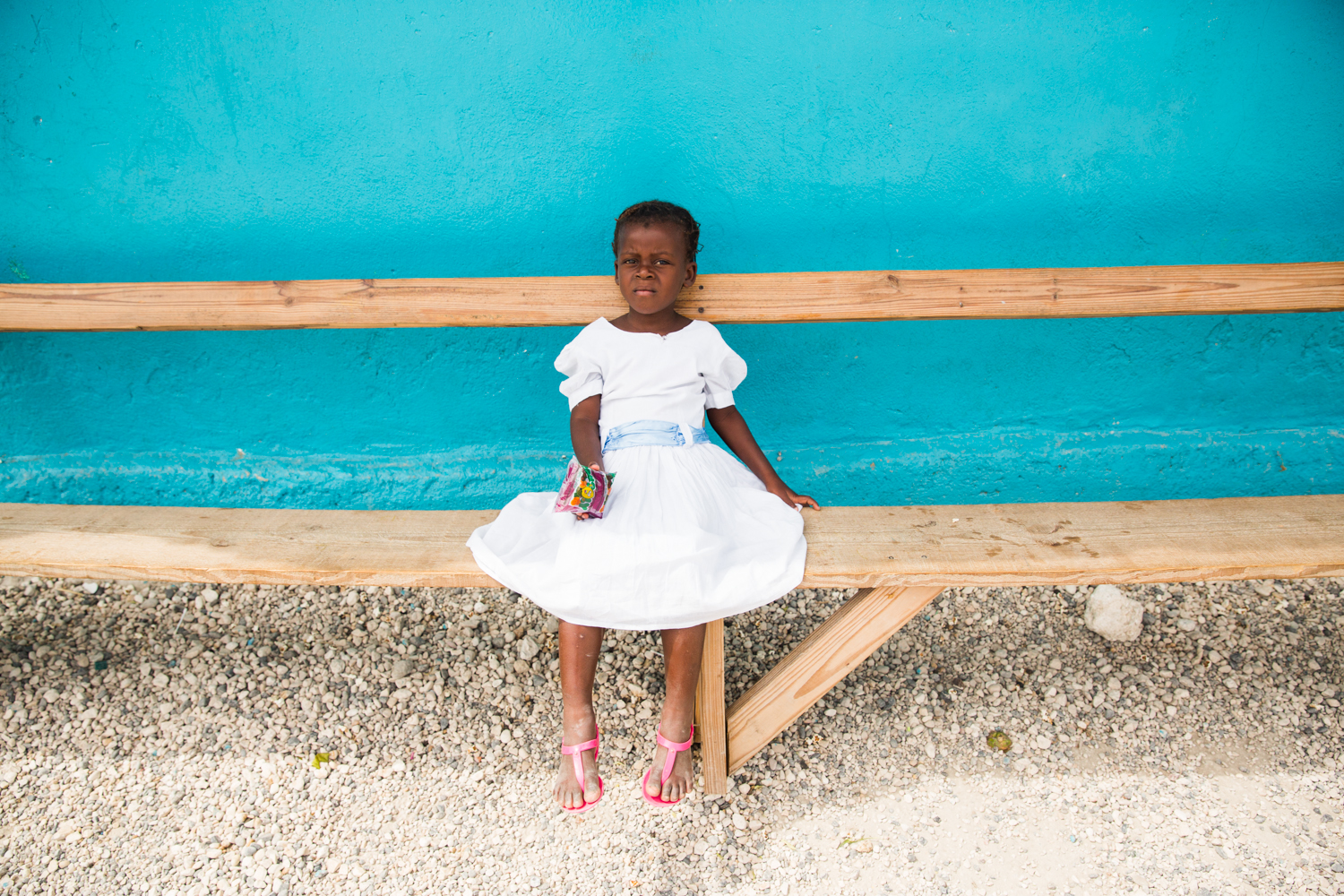 "Young girl taking a break during an Easter egg hunt in Despinos, Haiti. She lives in an orphanage in Despinos, Haiti that is run by ""Imagine Missions"", which houses, feeds, educates over 100 children."