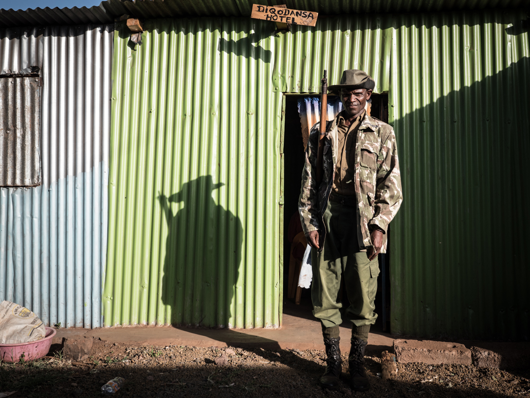 """Dabasso Abdula, 53, police volunteer. """"It's true that I wear a uniform, but I don't get any pay. All the members of the National Police Reserve are volunteers. We support the normal police, but only in the countryside – always in the places where we live. I'm actually a herder. We're chosen by the village community. Here in Marsabit District there are more than 1,500 of us. The normal police first trains us and then provides us with uniforms and rifles. We're supposed to maintain security in our villages and intervene in disputes. They're usually about the herds, cattle raiding for example... I'm not proud to be in the National Police Reserve. The job is not without risk, because the cattle rustlers are also armed. Some only have spears, others have rifles like us. The tribal fights often result in deaths. I myself have also shot, but I've never hit anyone. It's not that easy, especially when you're chasing people off-road at night."""""""