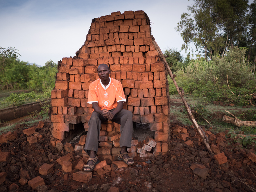 """Kennedy Otieno Okuk, 35, brick burner. """"After primary school I first became a fisherman, like most of the men here at Lake Victoria. Later, my brother took me to Eldoret. He's got a tailor's shop there. In the city I met someone who was burning bricks. I'd never seen anything like it. He had a lot of business and was a respected man. I was impressed by that, so I studied his technique and went back to my village, where nobody knew anything about bricks. There is enough clay on my piece of land, so it doesn't cost me anything. The only thing I have to buy is the firewood. Burning bricks has changed my life. Without it, I would be like everyone else."""""""