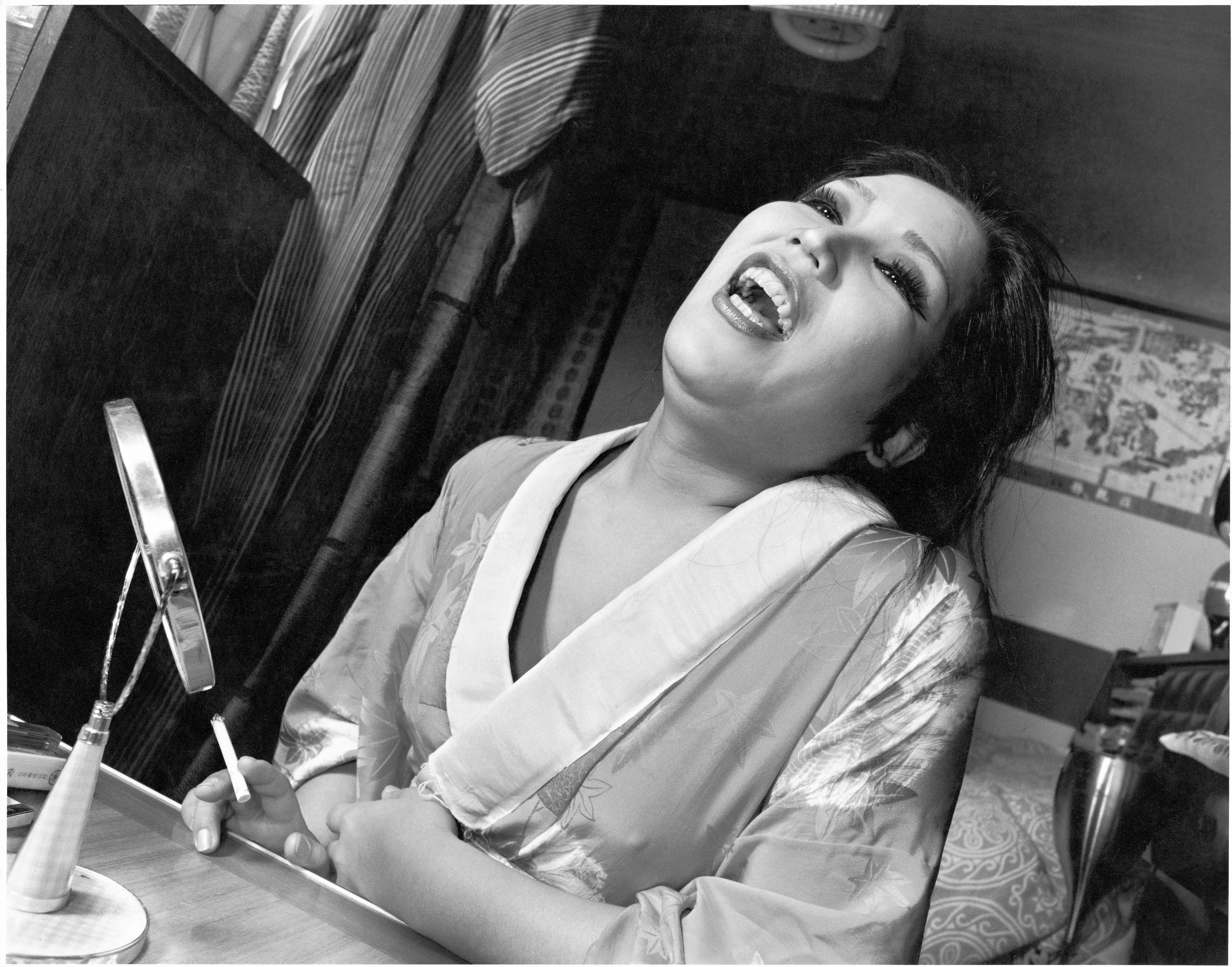Sister Akane, at home, laughing. Ikebukuro, Honcho, 1977 From the series Flash Up, 1975 -1979 Collection of Mark Pearson, Zen Foto Gallery