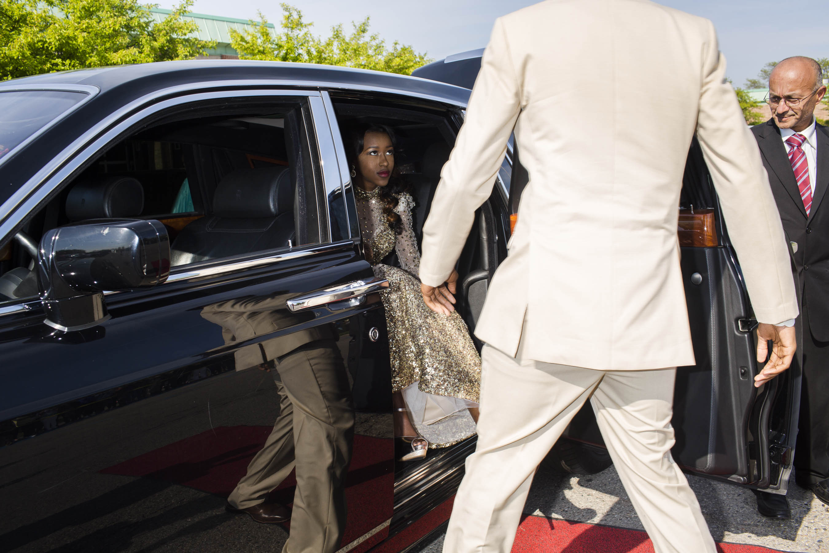 An unidentified student arrives in a limousine at the Northwestern High School prom on Saturday, May 21, 2016 in Flint, Michigan.
