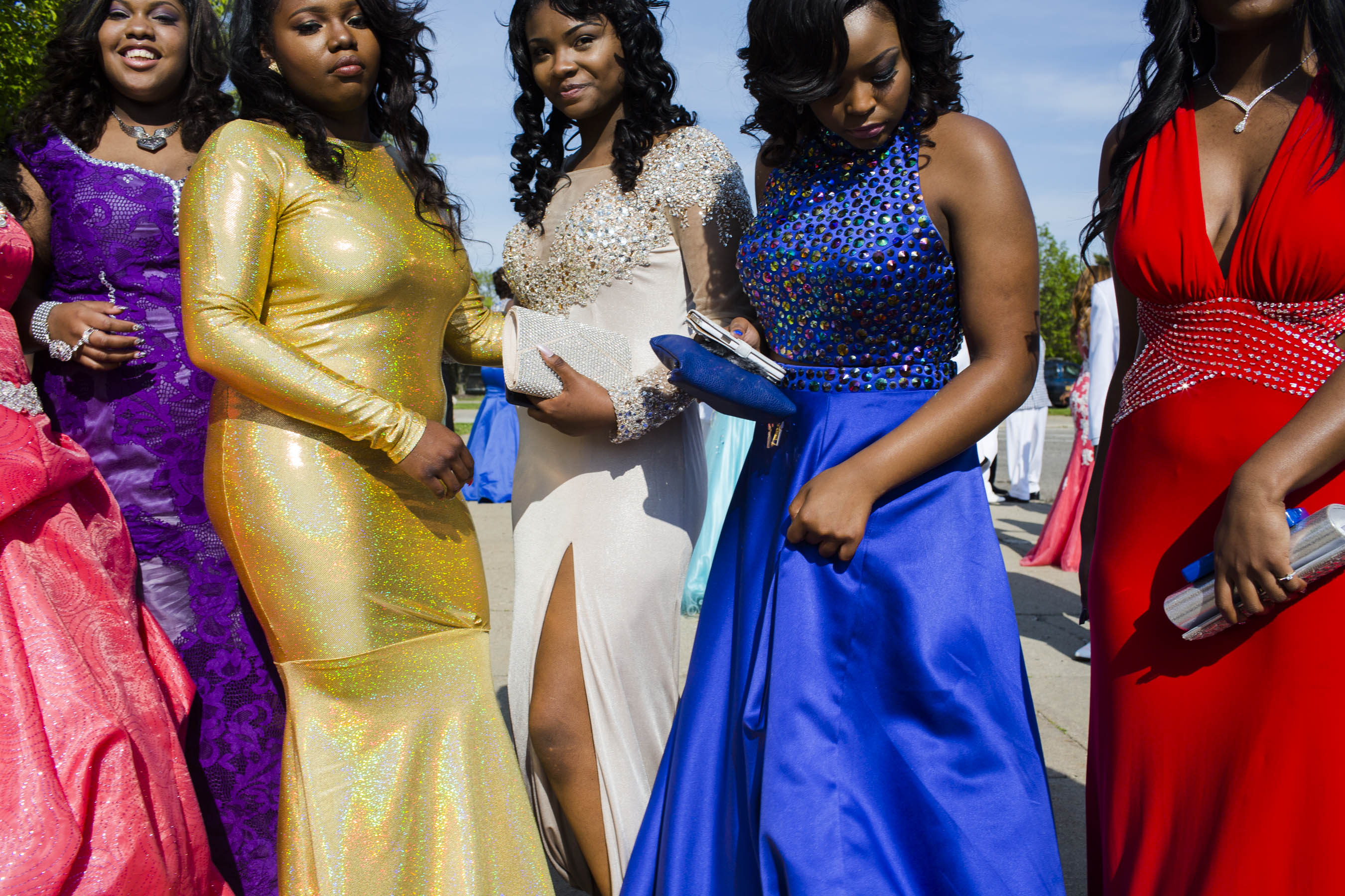 Northwestern High School students prepare for a group photo before their prom on Saturday, May 21, 2016 in Flint, Michigan.