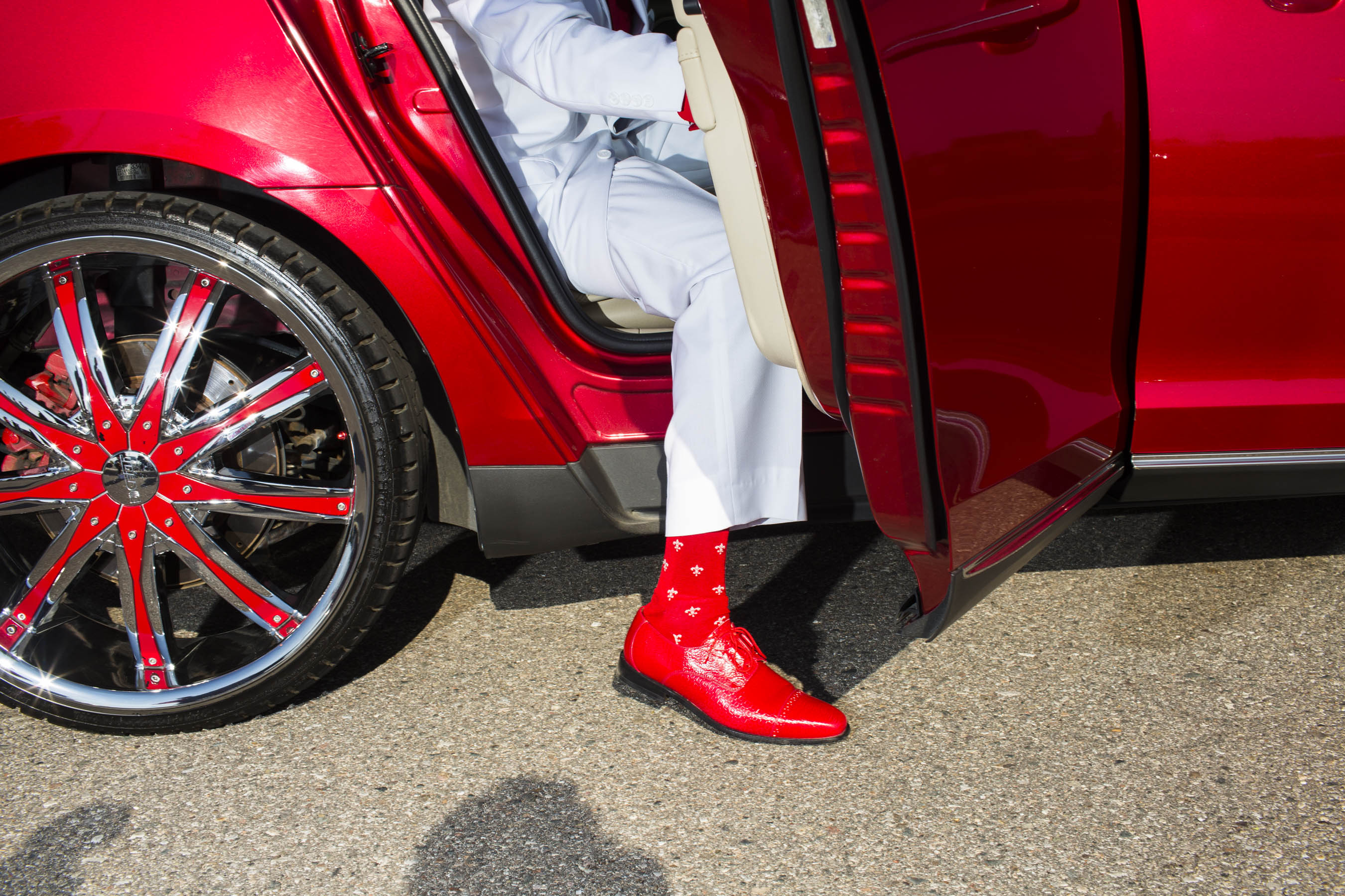 A student's shoes and socks match his ride on the way to the Northwestern High School Prom on Saturday, May 21, 2016 in Flint, Michigan.