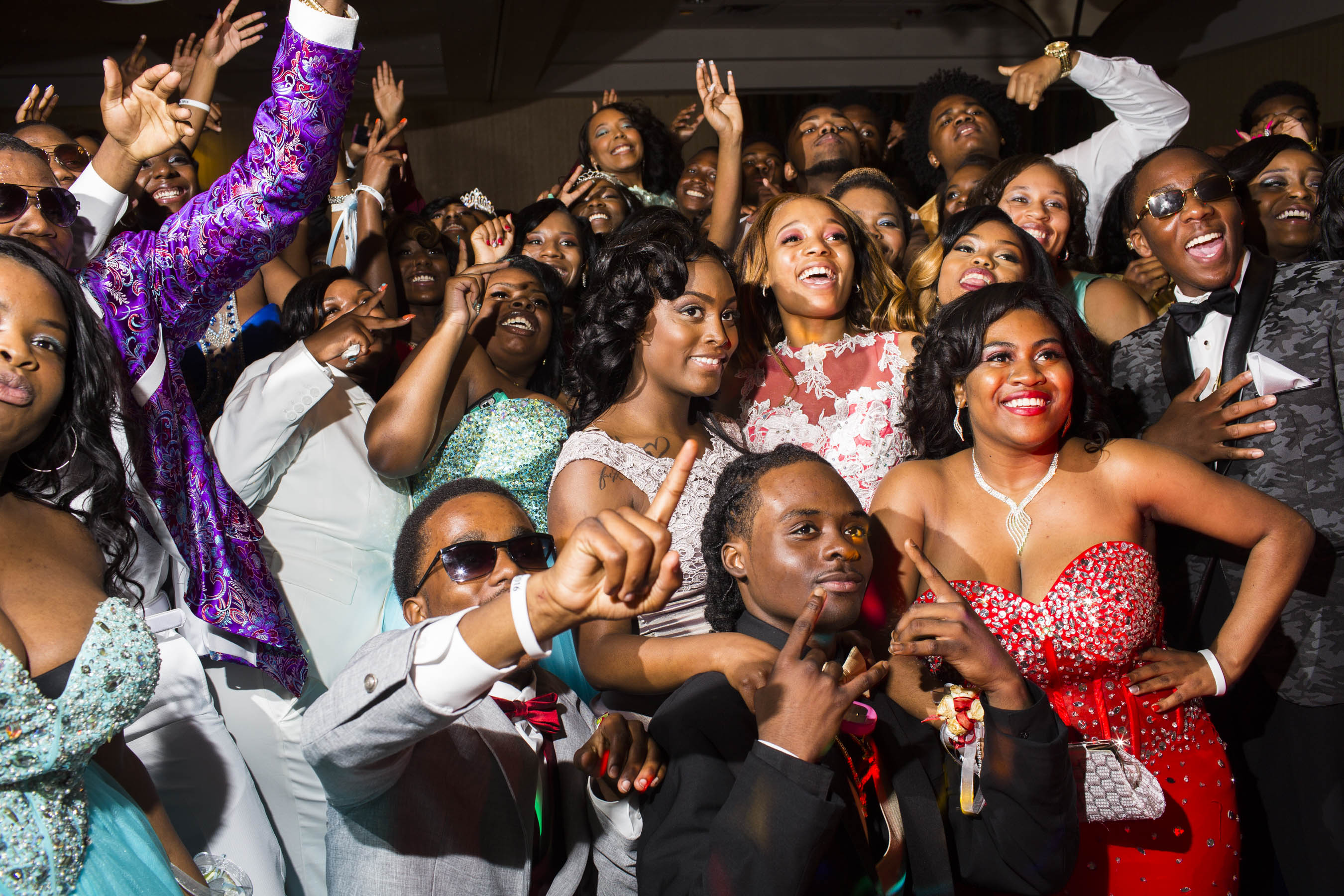 Students on the dance floor pose for a group photo at the  Northwestern High School  prom on Saturday, May 21, 2016 in Flint, Michigan.