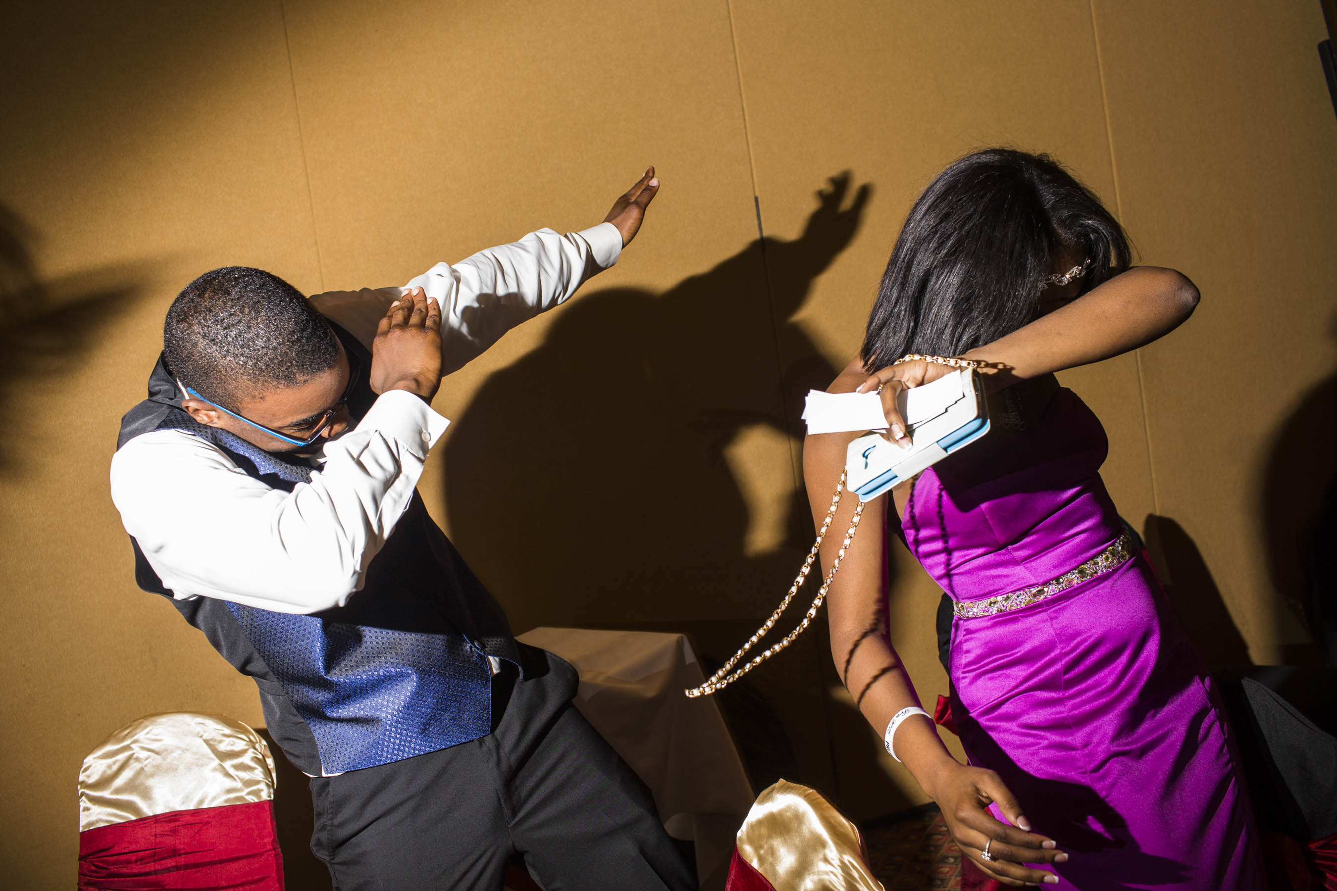 """Unidentified students """"dab"""" during the Northestern High School prom on Saturday, May 21, 2016 in Flint, Michigan."""