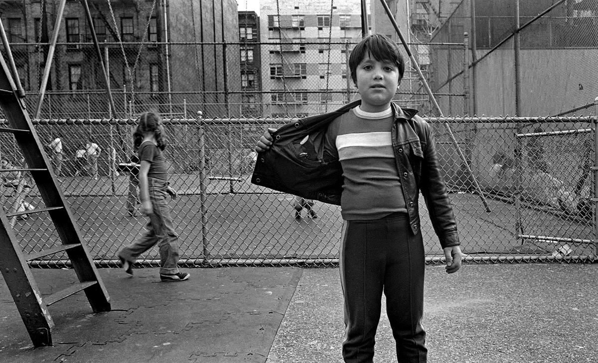 Boy with gun in playground
