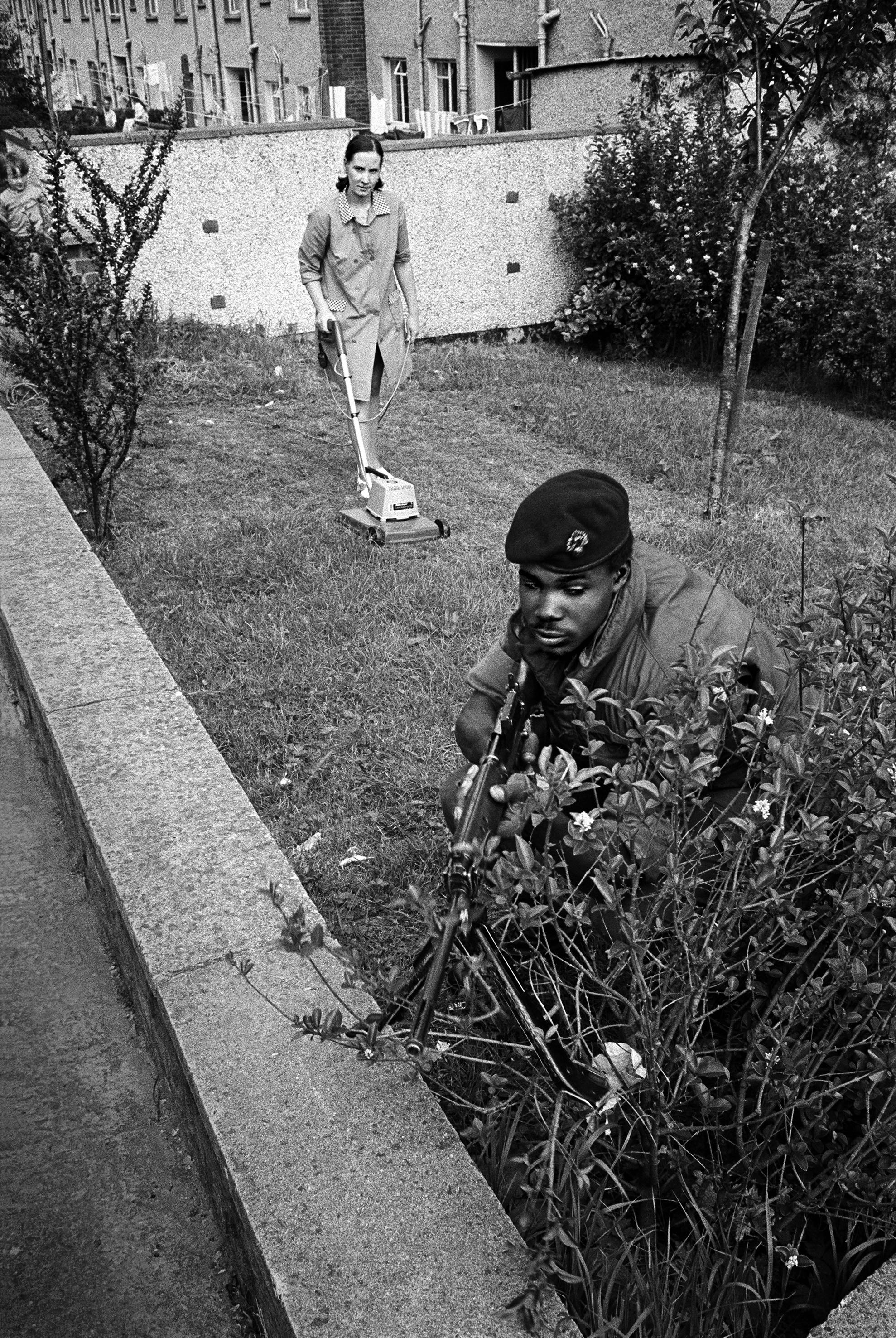 Mowing the Lawn, Northern Ireland, 1973 © Philip Jones Griffiths / Magnum Photos