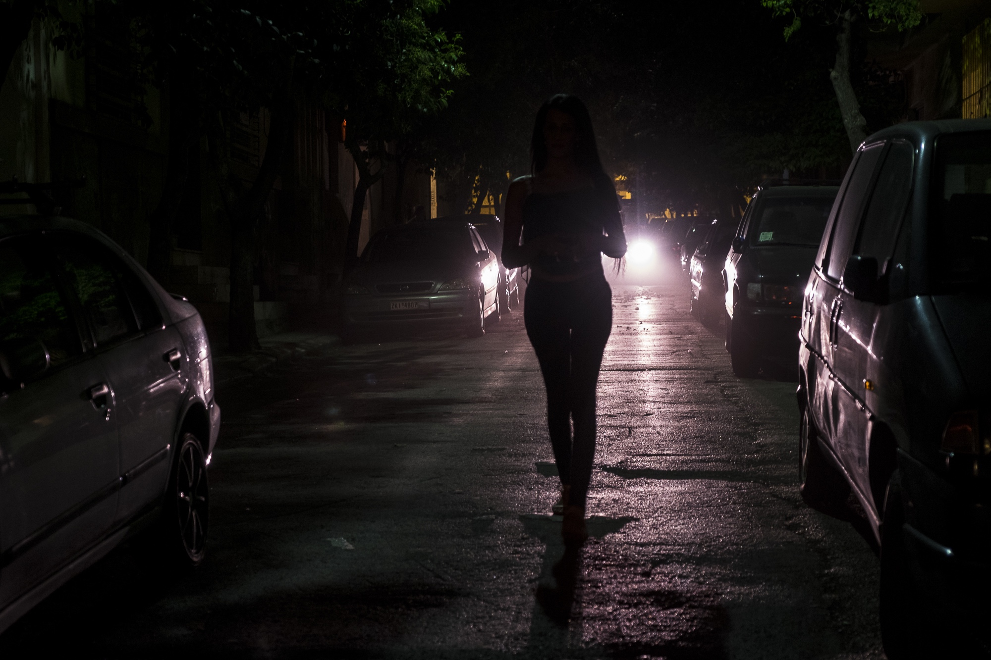 A., 24, a trans woman from the Middle East (who asked not to have her nationality revealed for security reasons), walks down the street on her way to meet some friends at a bar in Athens, Greece. August 6, 2017.