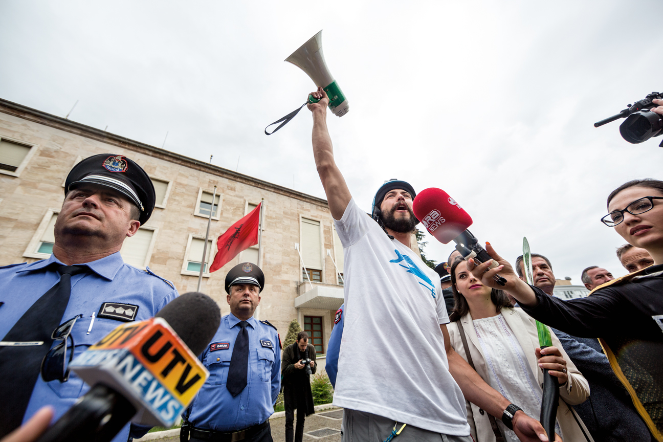 Rok Rozman, a Slovenian Olympic rower and now pro kayaker, protests the onslaught of hydropower dams throughout the Balkans in Tirana, Albania.