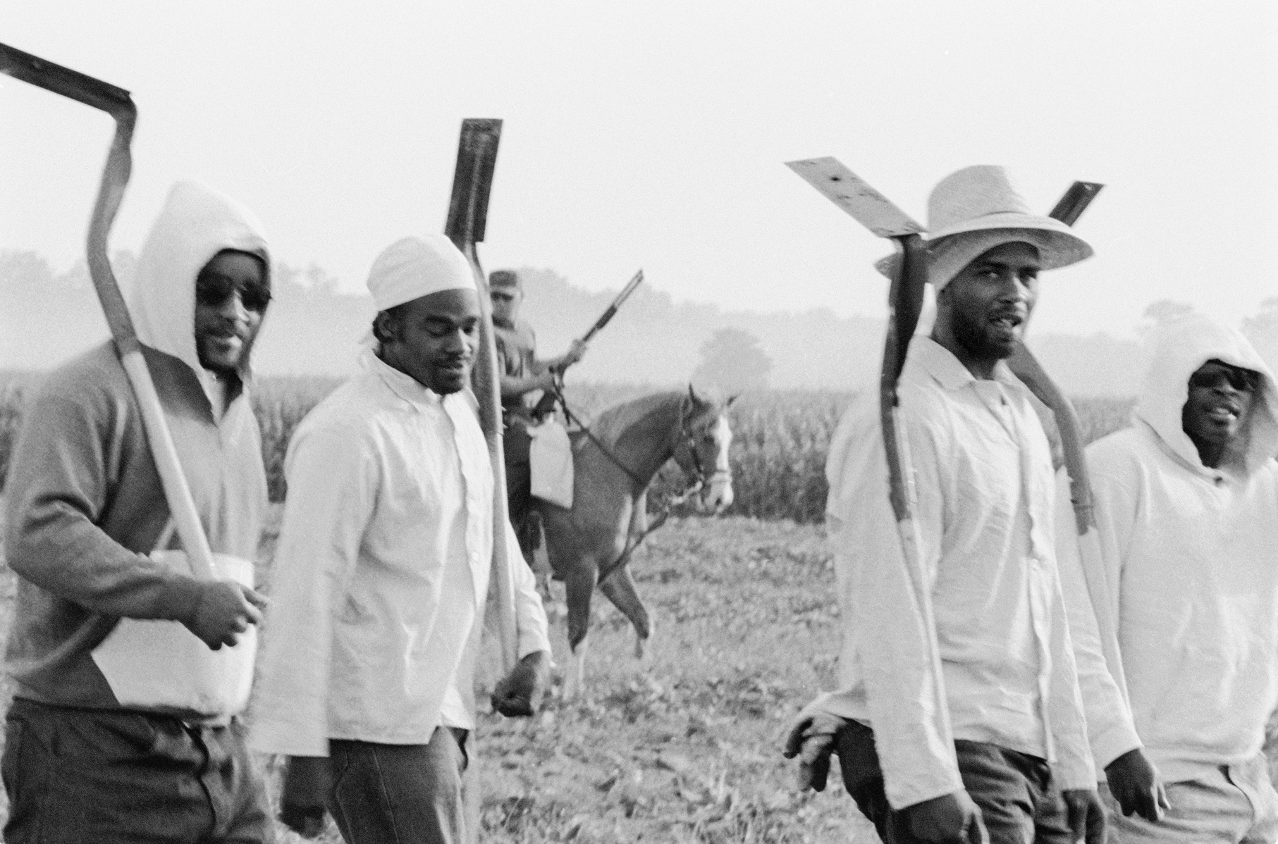 Chandra McCormick. MEN GOING TO WORK IN THE FIELDS OF ANGOLA, 2004.
