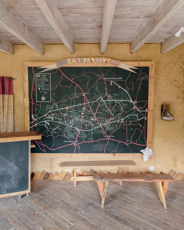The ZAD reception at La Rolandière, where first-time visitors can receive more information about the ZAD. On the wall is a map which shows the occupied zone and the different collectives along the territory.