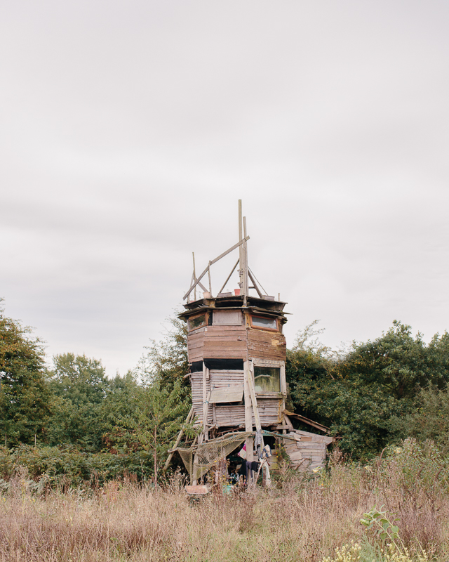 Le Tour, a tower which Alex has built from only found wood. He and his dog will live here until his mud house is finished.