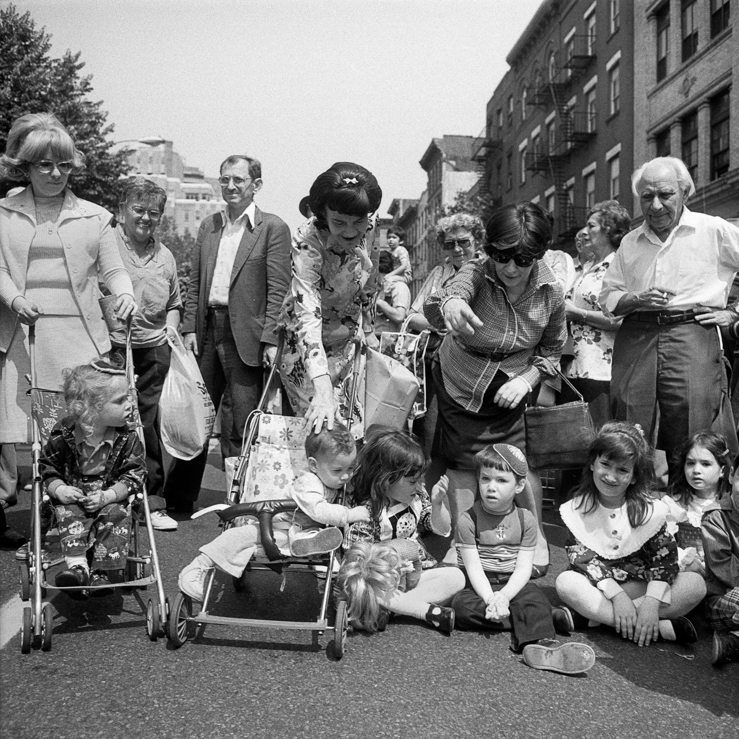Baby carriages, children and adults at the Lower East Side Street Festival NY, NY June 1978