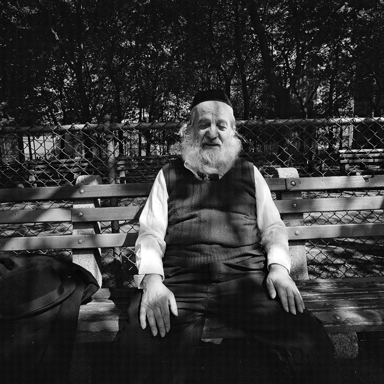White bearded man on park bench in dappled sunlight NY, NY May 1977