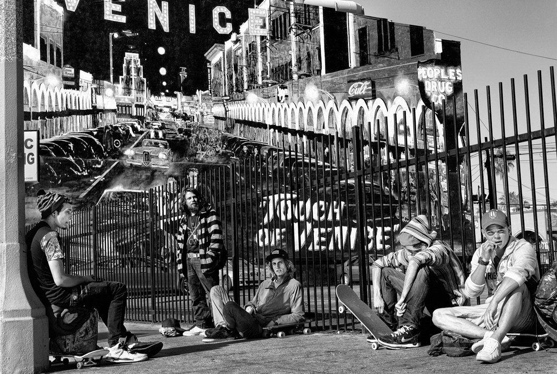 A group of young skateboarders gather to smoke marijuana in the early morning sun in front of the iconic Touch of Venice mural on Wind- ward Avenue.© Dotan Saguy
