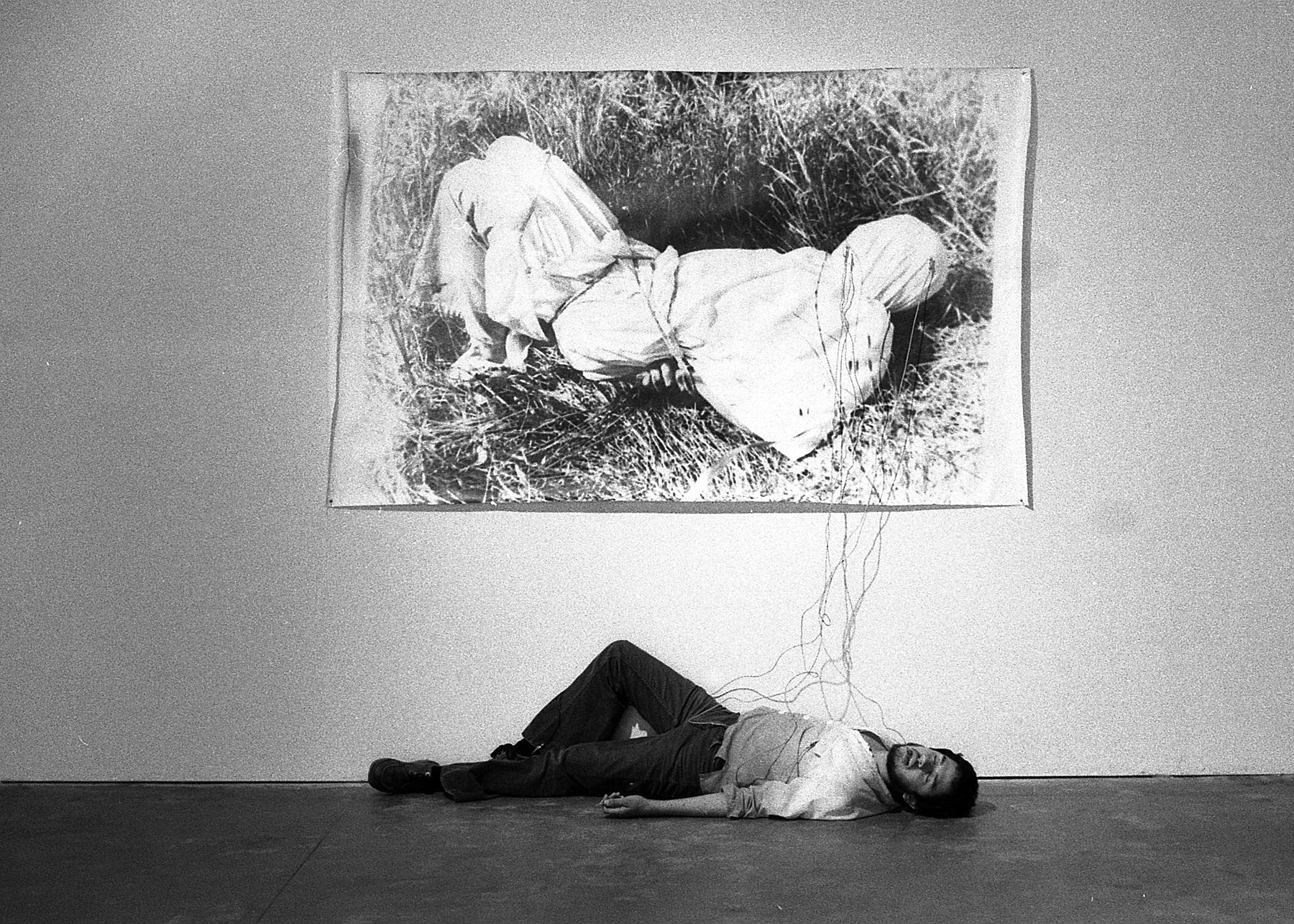 Harry Gamboa Jr., Roberto Gil de Montes, 1978. Gil de Montes shown with his work Tongue Tied in the No Movie exhibition at LACE (Los Angeles Contemporary Exhibitions), May 2–31, 1978. © 1978, Harry Gamboa Jr.