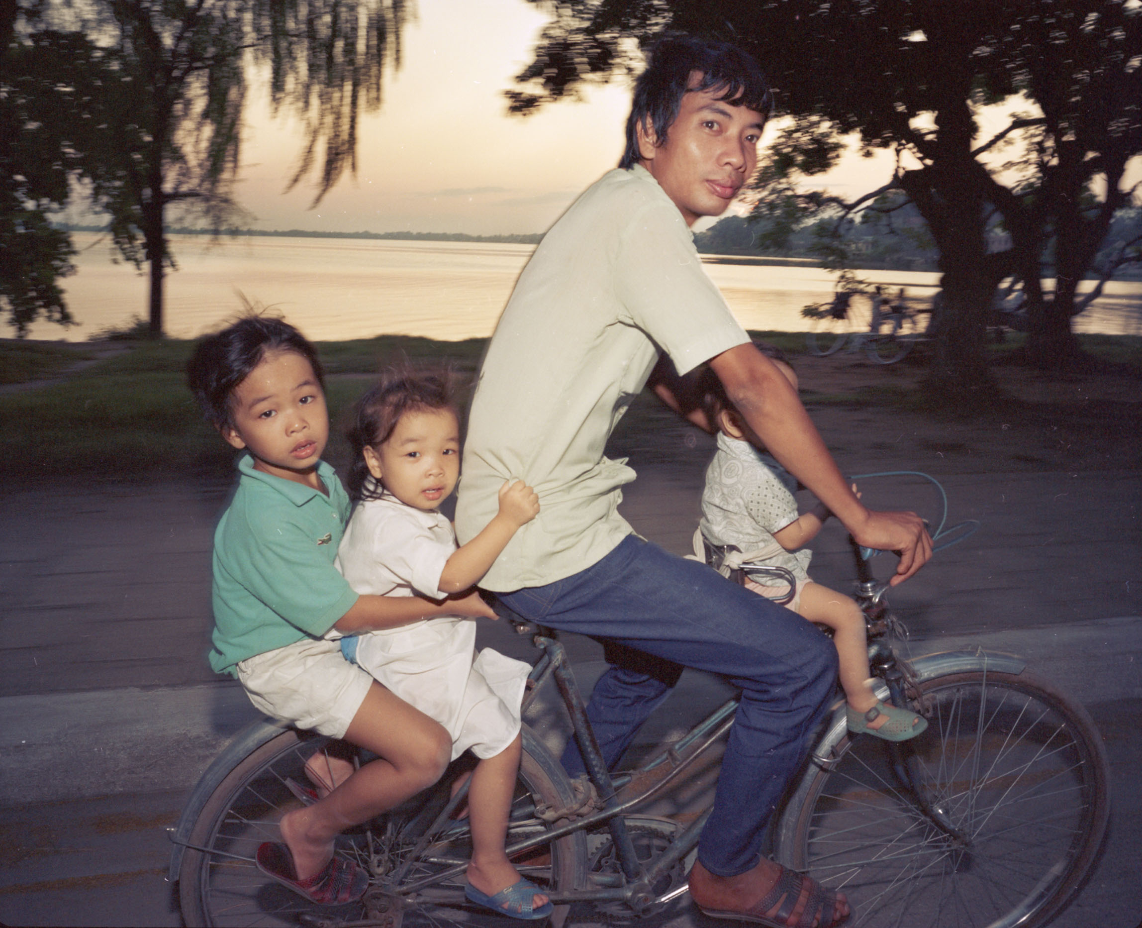 Motobike and Bicycles Going Home, 1987 © William E. Crawford