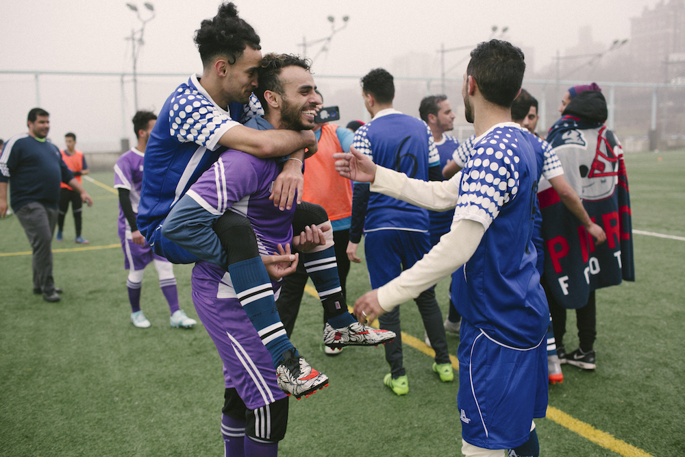 Yosef Aymar and Ahmed Elsamet joke around with their teammates after a training session.