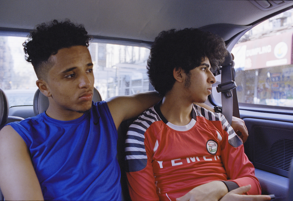 Ahmed Alzandhani and Osama Alsahybi ride in the back of Heidara Nasser's van after an early morning friendly game in the Bronx.