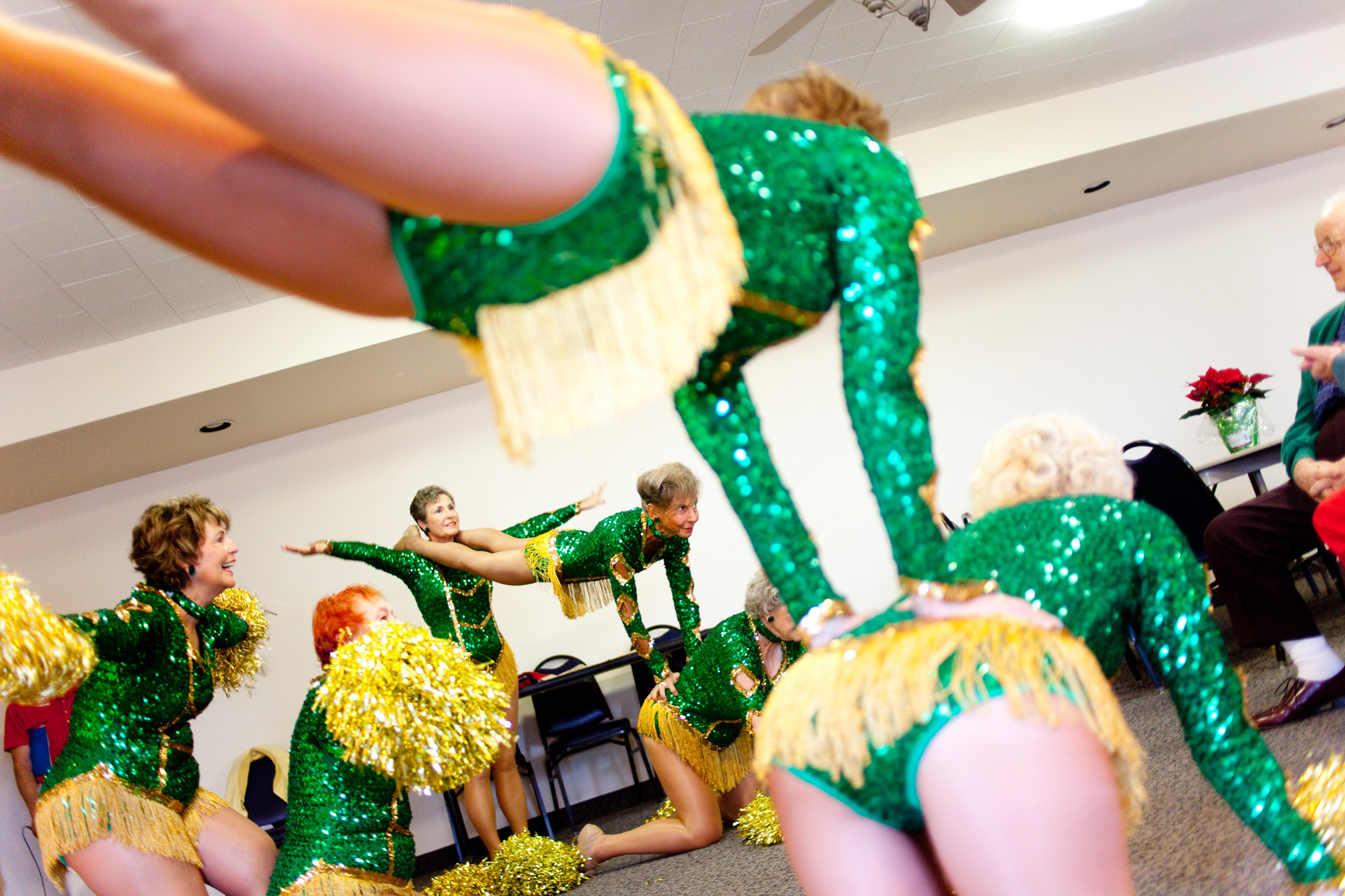 "The Sun City Poms, aged 61-78, perform for a routine for a crowd in Talisman Hall December 12, 2009. The start of their routine includes an announcement that one is ""never too old to perform and expand your horizons."""