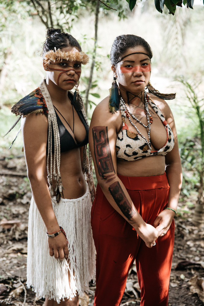 Two indigenous brazilian women in traditional clothing