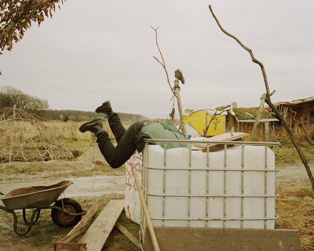 An ecoactivist dives into a collection of rubbish