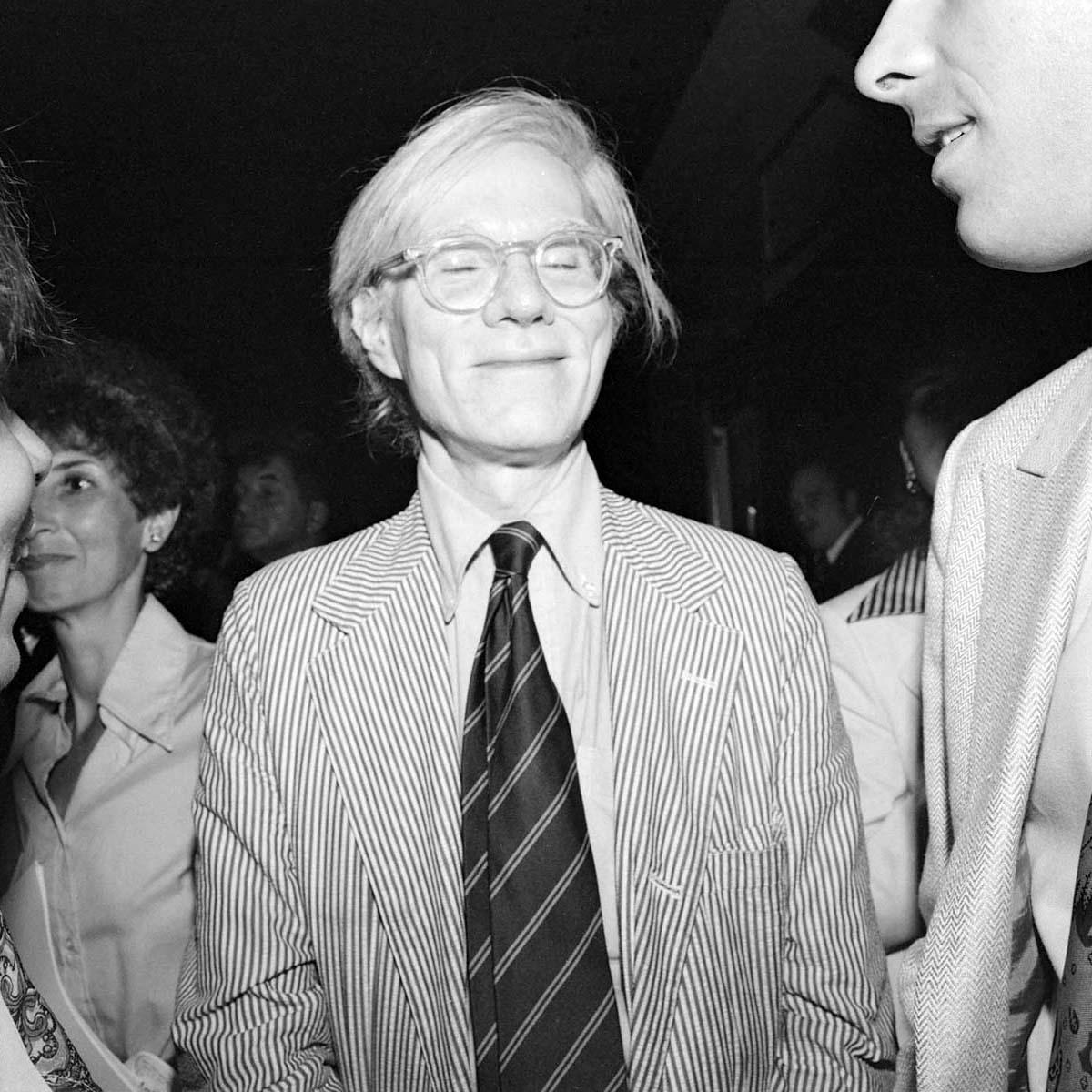 Warhol Eyes Closed (between his friend and Judi Jupiter), Studio 54, July 1977