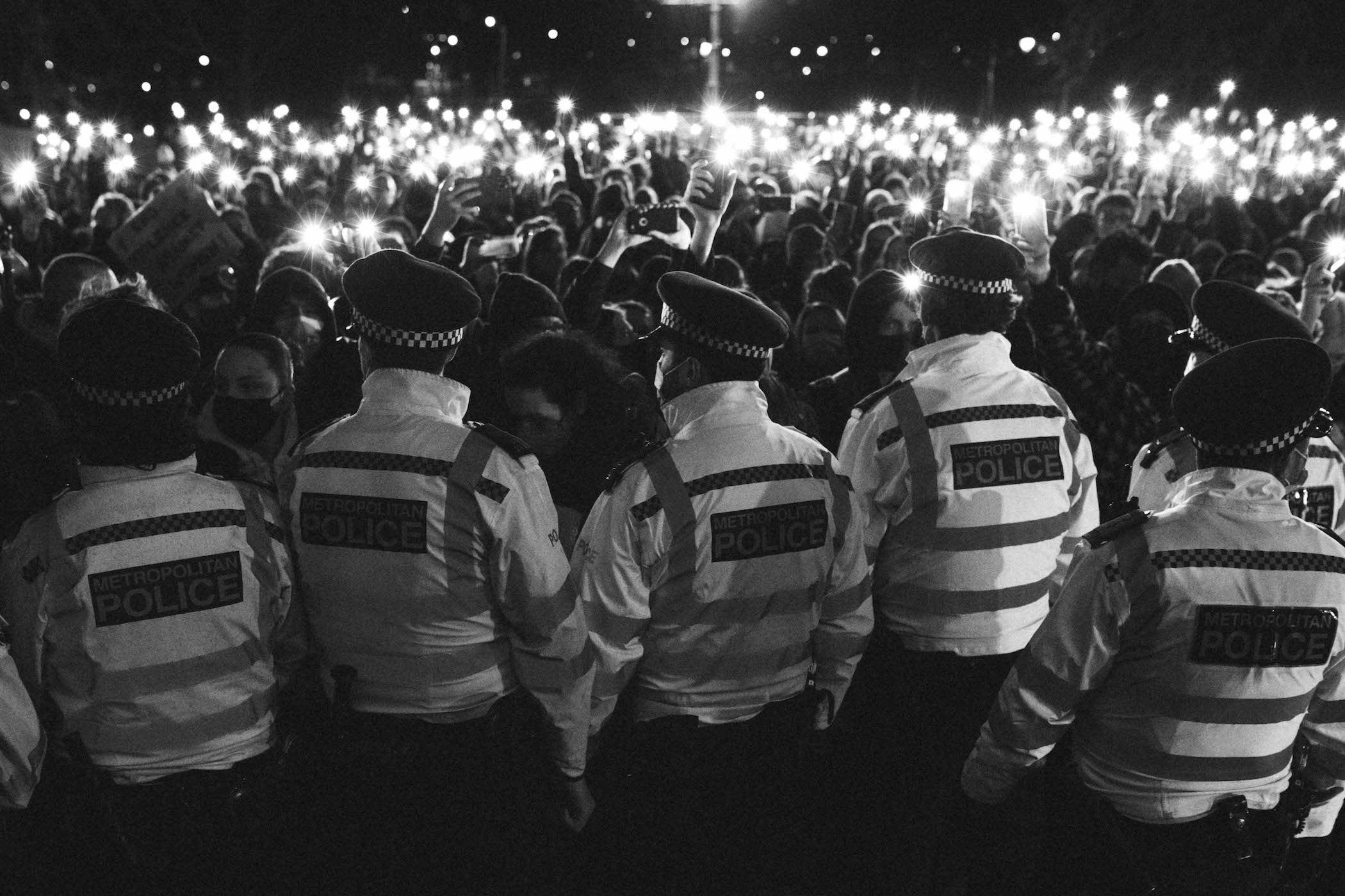 Police storming the vigil for Sarah Everard, in photos